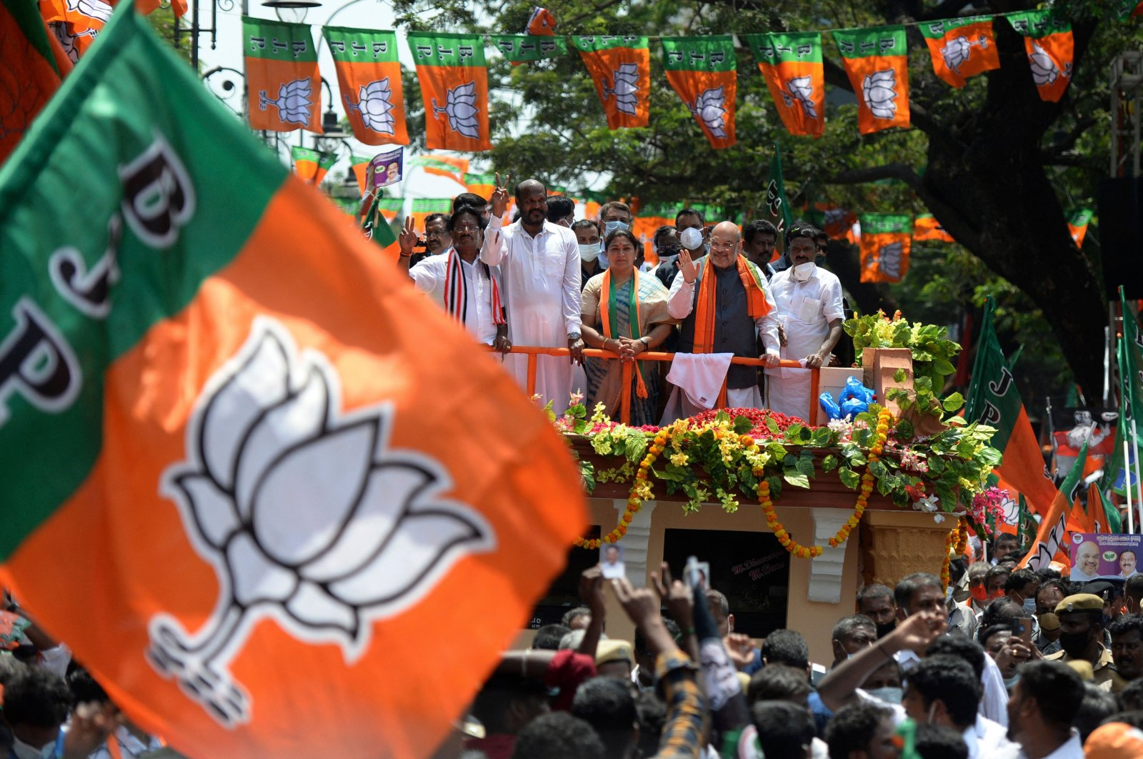 Amit Shah (top 3R), India's home minister and leader of the Bharatiya Janata Party (BJP), takes part in a roadshow ahead of the Tamil Nadu state legislative assembly elections in Chennai, India, April 3, 2021. (AFP Photo)