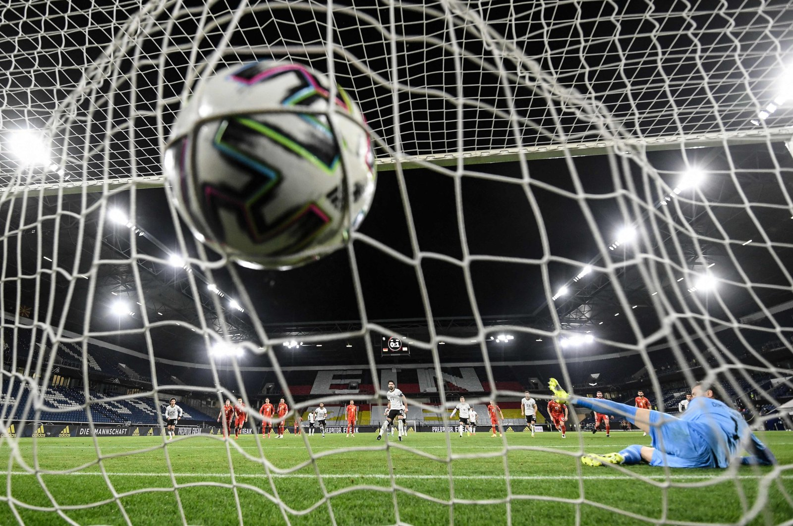 Germany's midfielder Ilkay Gundogan scores the 1-1 from the penalty spot past North Macedonia's goalkeeper Stole Dimitrievski (R) during the FIFA World Cup Qatar 2022 qualification football match Germany versus North Macedonia in Duisburg, western Germany, March 31, 2021. (AFP Photo)