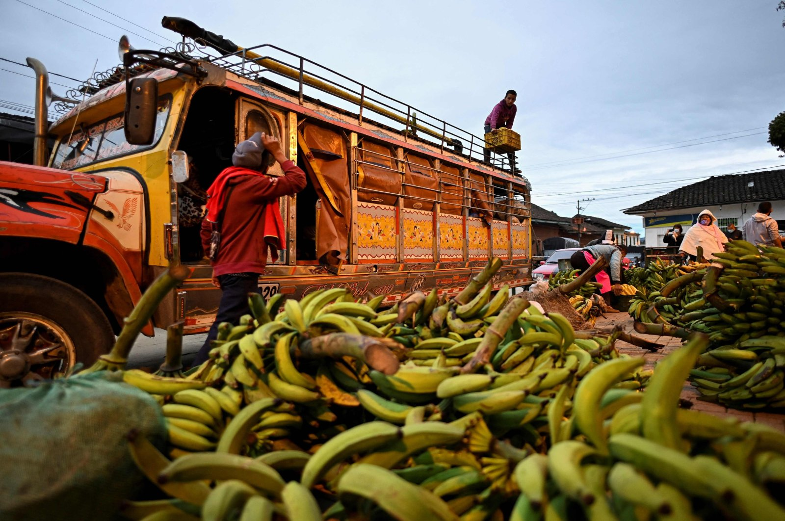 People unload fruits and vegetables from a transport vehicle in Silvia, Colombia, South America, March 9, 2021. (AFP Photo)
