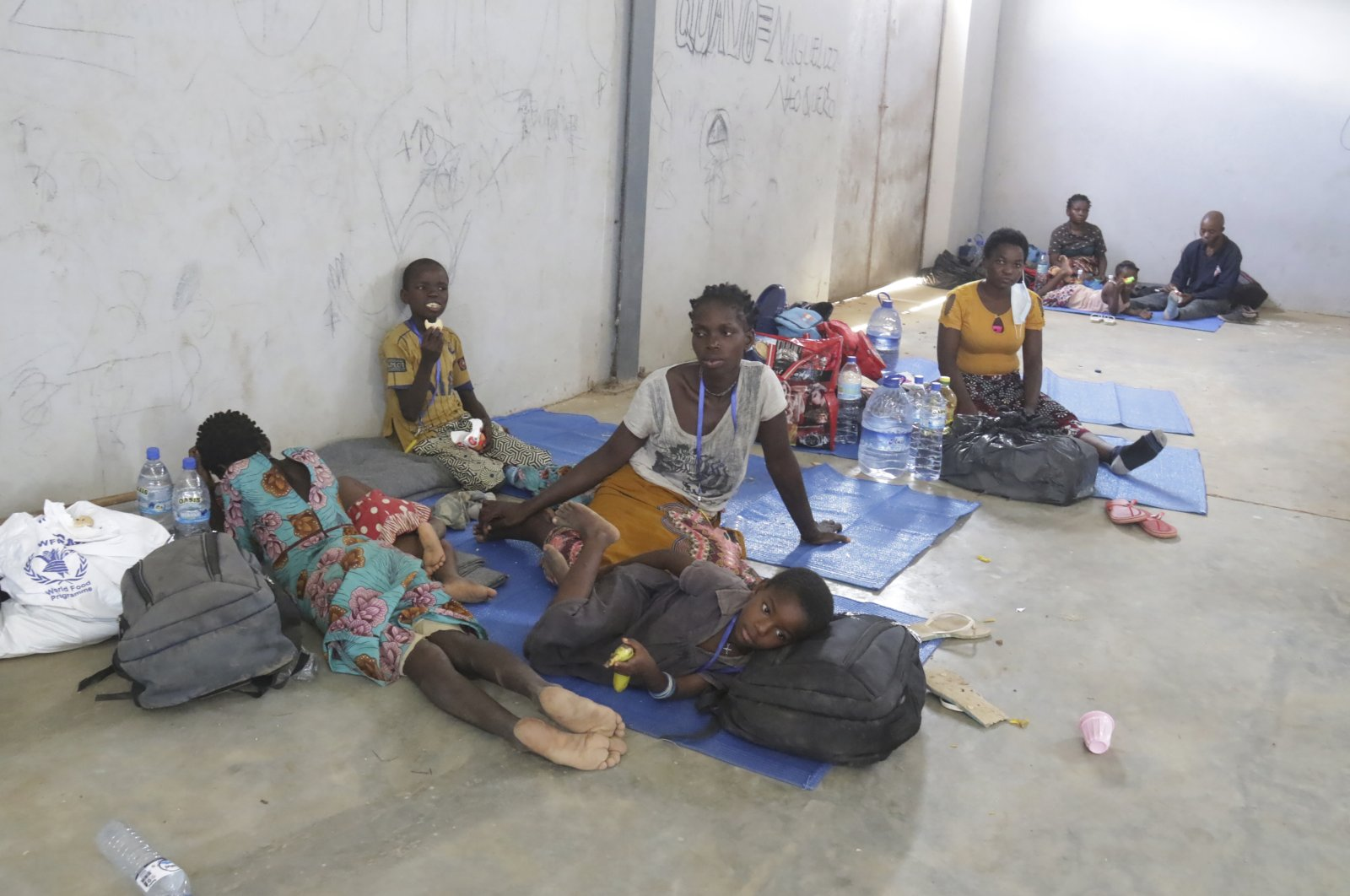 Refugees seek shelter at a center after fleeing attacks in Palma in northern Mozambique, in Afungi, Mozambique, April 2, 2021. (AP Photo)