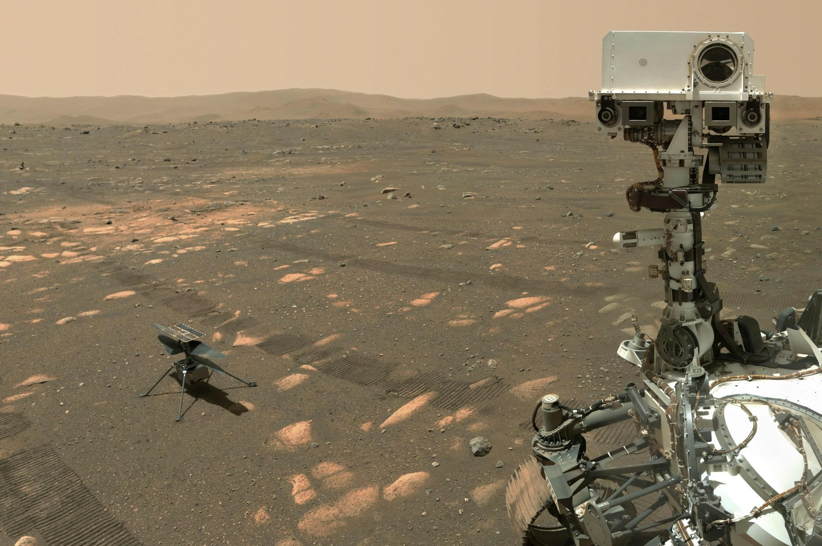 The Perseverance Mars rover in a selfie taken with the WATSON (Wide Angle Topographic Sensor for Operations and eNgineering) camera with the Ingenuity helicopter, seen here about 13 feet (3.9 meters) from the rover, on the 46th Martian day, or sol, of the mission, or April 6, 2021. (Photo by Handout / NASA/JPL-Caltech/MSSS / AFP)