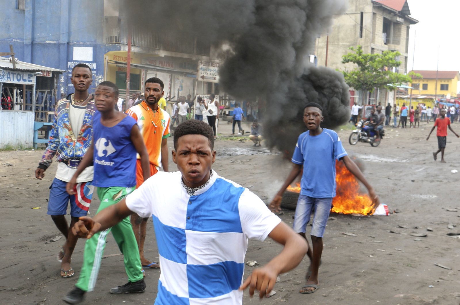 Congolese boys take part in a protest against President Joseph Kabila's refusal to step down from power in Kinshasa, Democratic Republic of Congo, Dec. 31, 2017. (AP Photo)