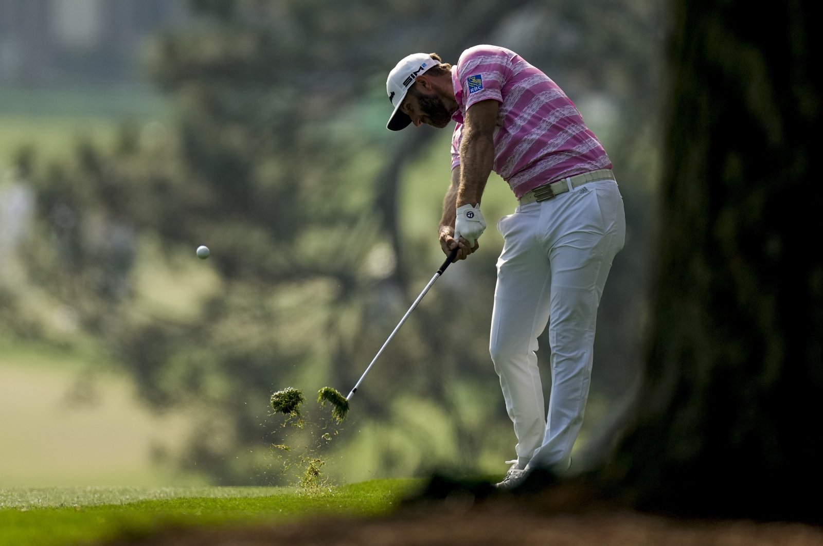 Dustin Johnson hits on the first fairway during the first round of the Masters golf tournament, Augusta, Ga., U.S., April 8, 2021. (AP Photo)