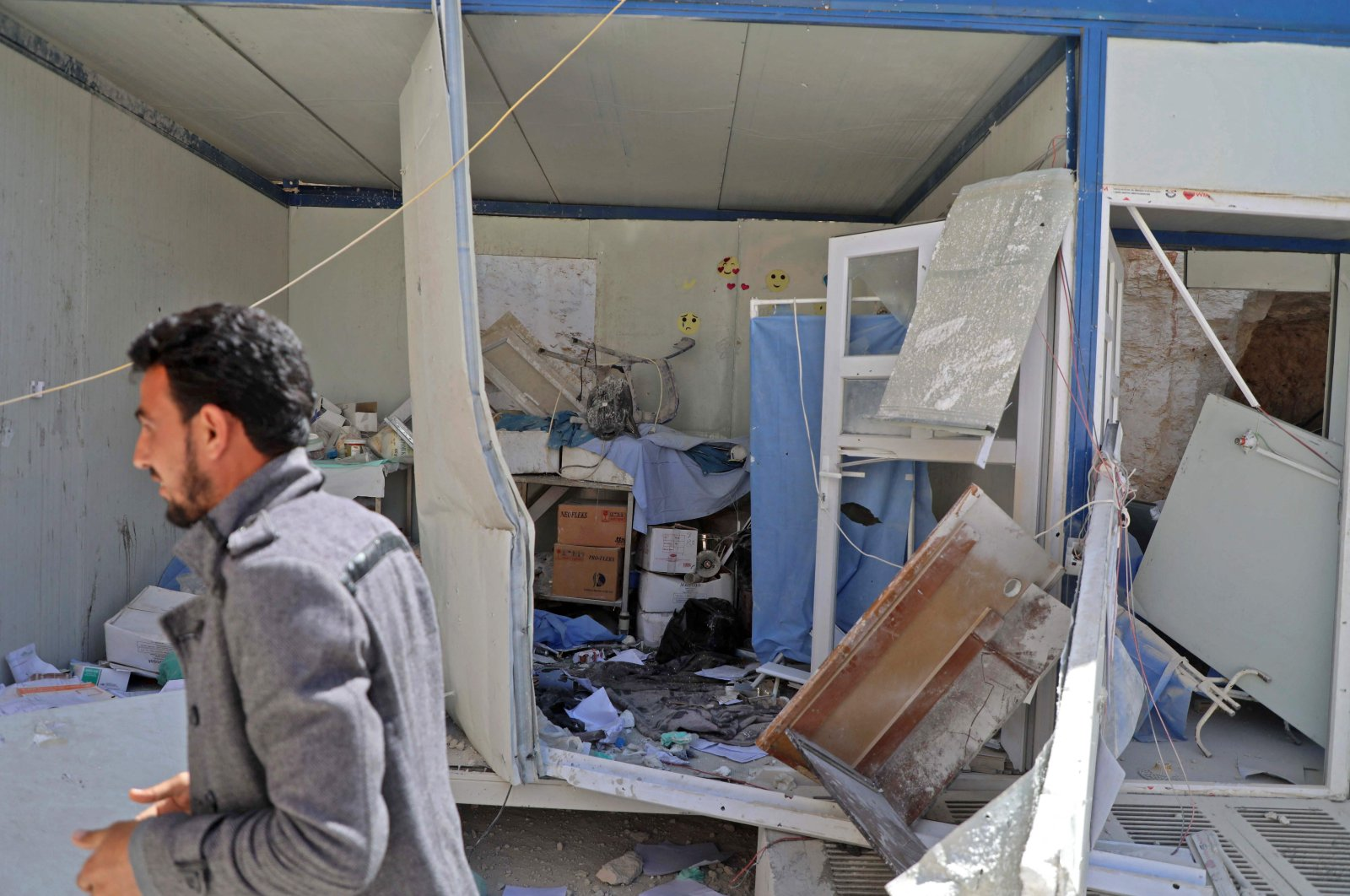 A man walks past a damaged room at the entrance of a field hospital in the village of Atareb in the northern Syrian province of Aleppo, Syria, on March 21, 2021. (AFP Photo)