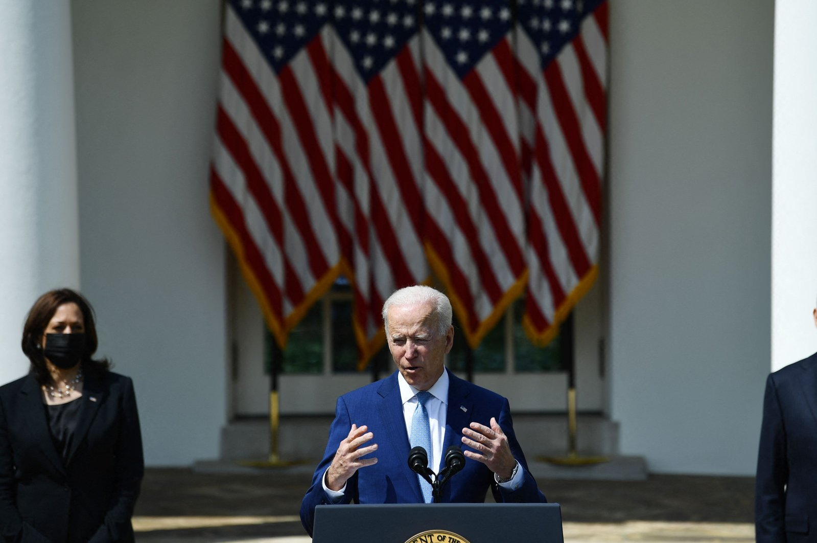 U.S. President Joe Biden (C) speaks about gun violence prevention with Vice President Kamala Harris (L) and Attorney General Merrick Garland in the Rose Garden of the White House in Washington, D.C., on April 8, 2021. (AFP Photo)