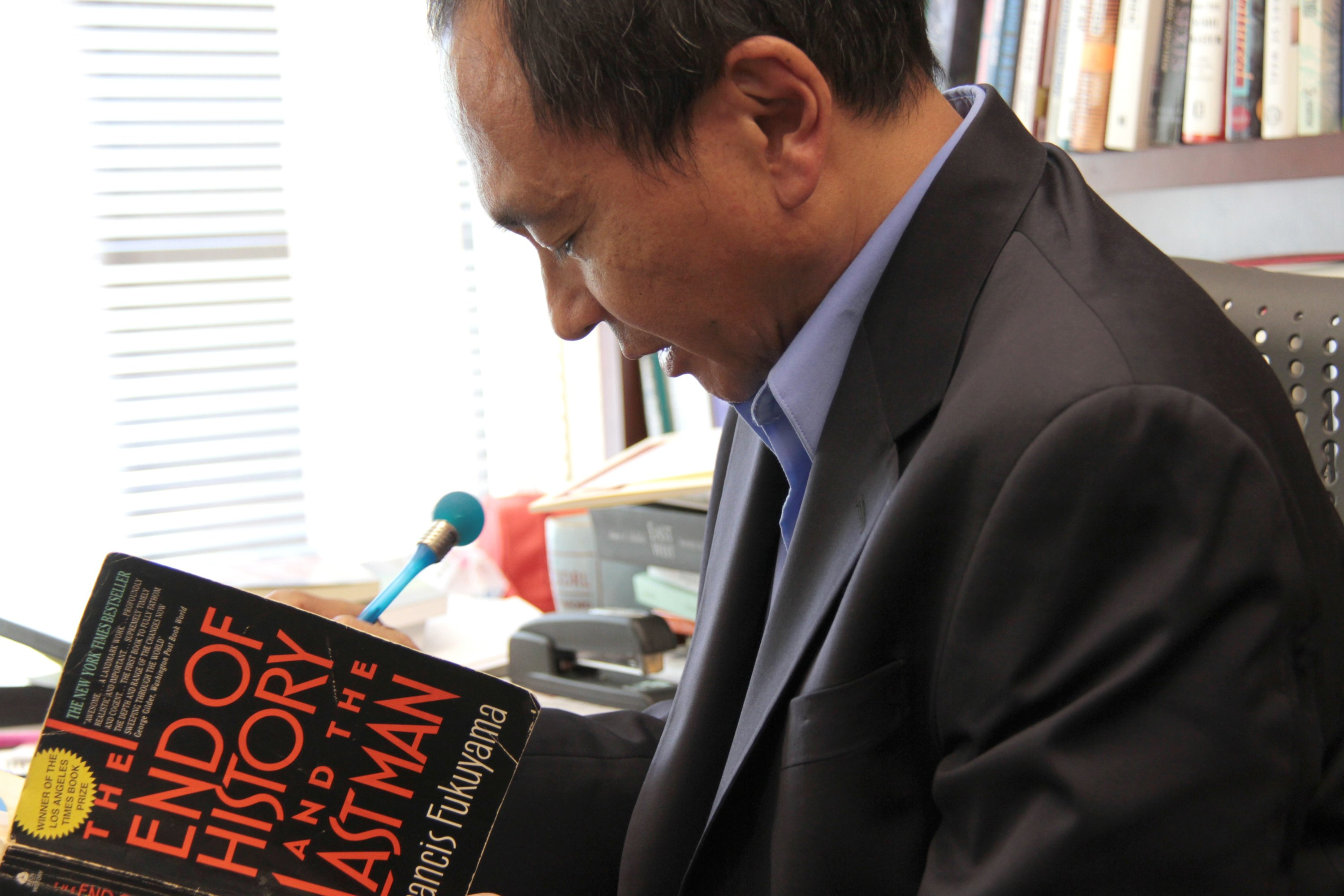 Francis Fukuyama holds his famous book 'The End of History and the Last Man' while speaking during an interview at a class in Stanford University, California, U.S., Aug. 9, 2011. (Reuters Photo)