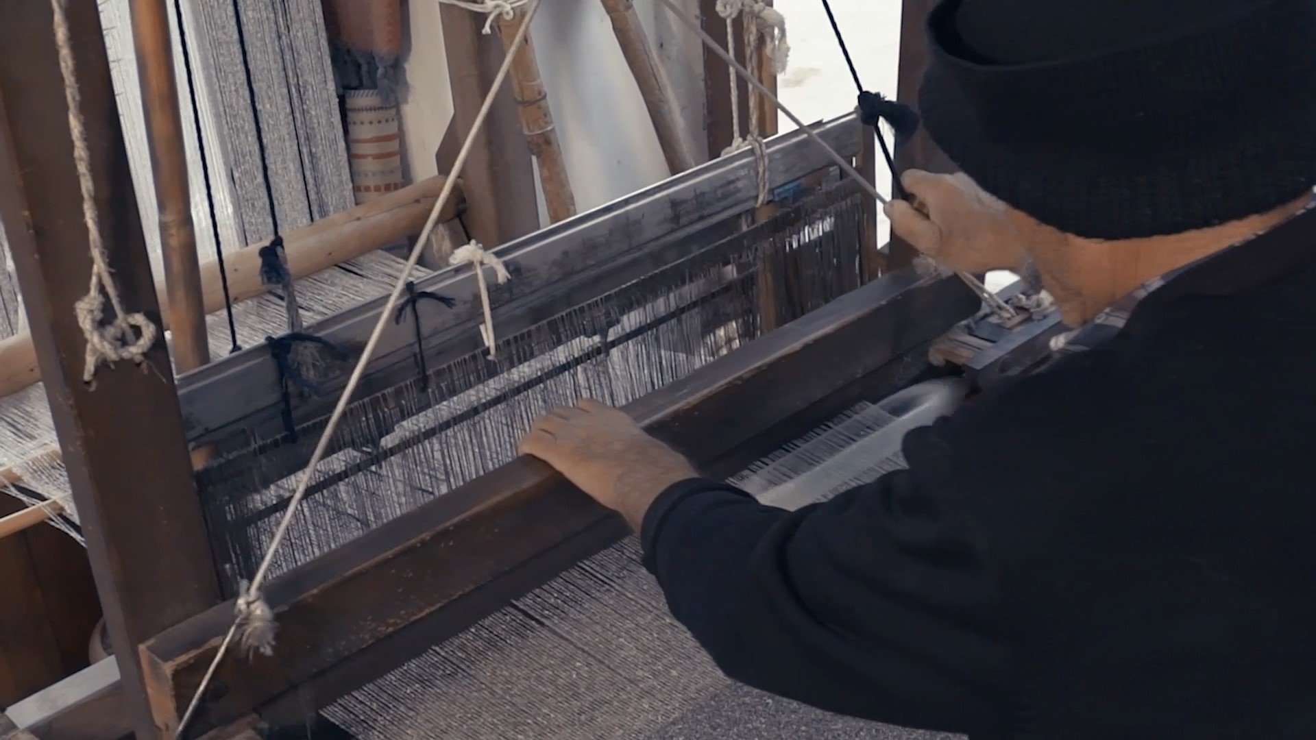 A weaver weaves silk fabrics on a loom. (Courtesy of Ministry of Culture and Tourism)