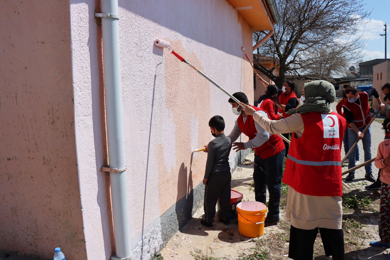 Turkish Red Crescent volunteers paint the wall of a school in Polatlı village near the Syrian border, Kilis, April 9, 2021. (AA)