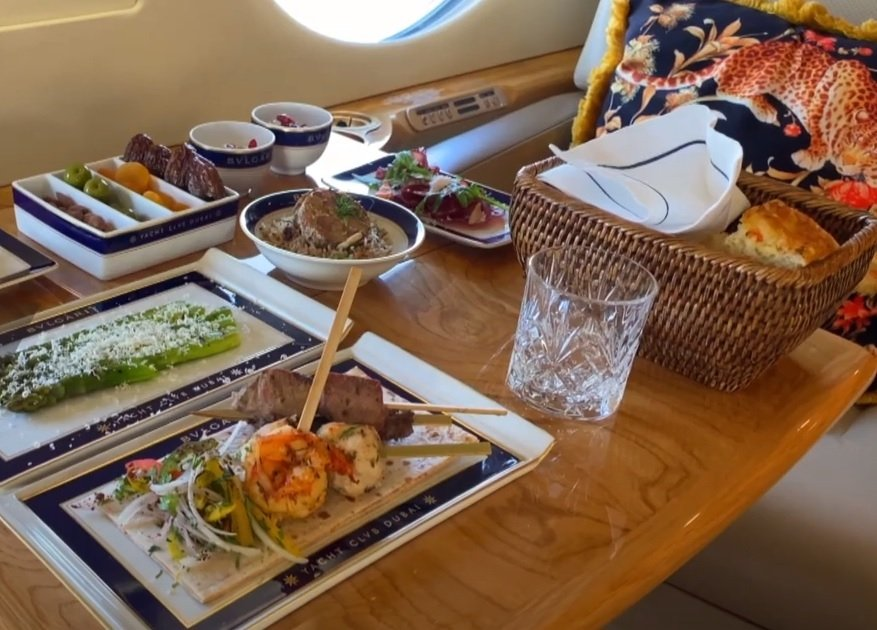 A variety of dishes are served on a private jet, Dubai, April 6, 2021. (DHA Photo)