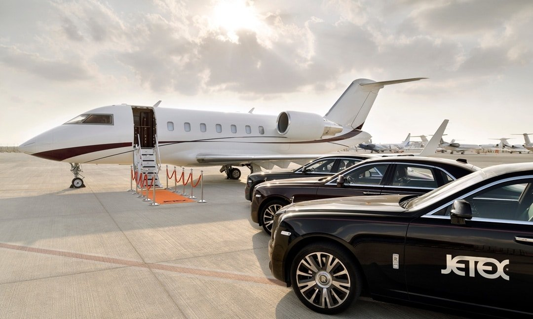 A set of luxurious cars stand parked next to a private jet, Dubai, April 6, 2021. (DHA Photo)