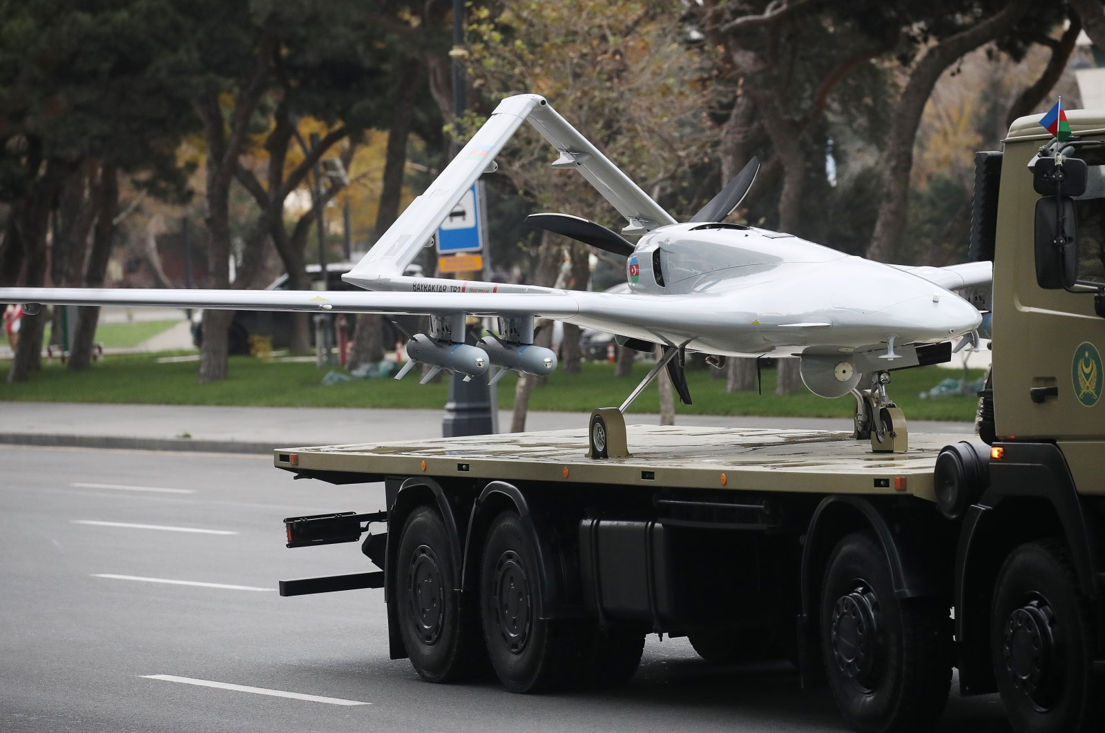 A truck carries a Bayraktar TB2 unmanned combat reconnaissance aerial vehicle manufactured by Turkey's Baykar Makina company during a rehearsal of a military parade in Baku, Azerbaijan, Dec. 9, 2020. (Photo by Getty Images)