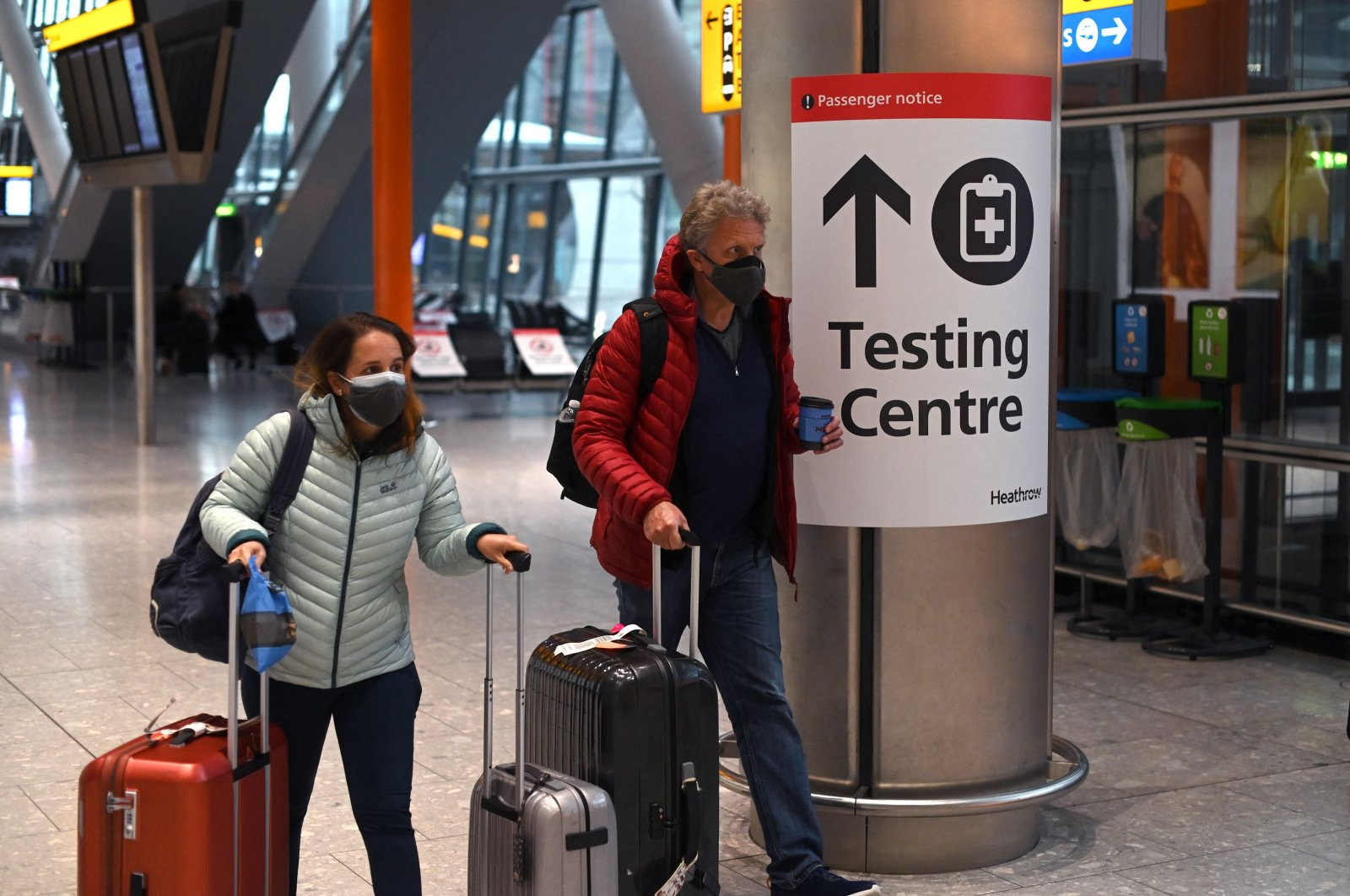 A sign directs passengers to a COVID-19 testing center at Terminal 5 of London Heathrow Airport in west London, the U.K., Feb. 9, 2021. (AFP Photo)