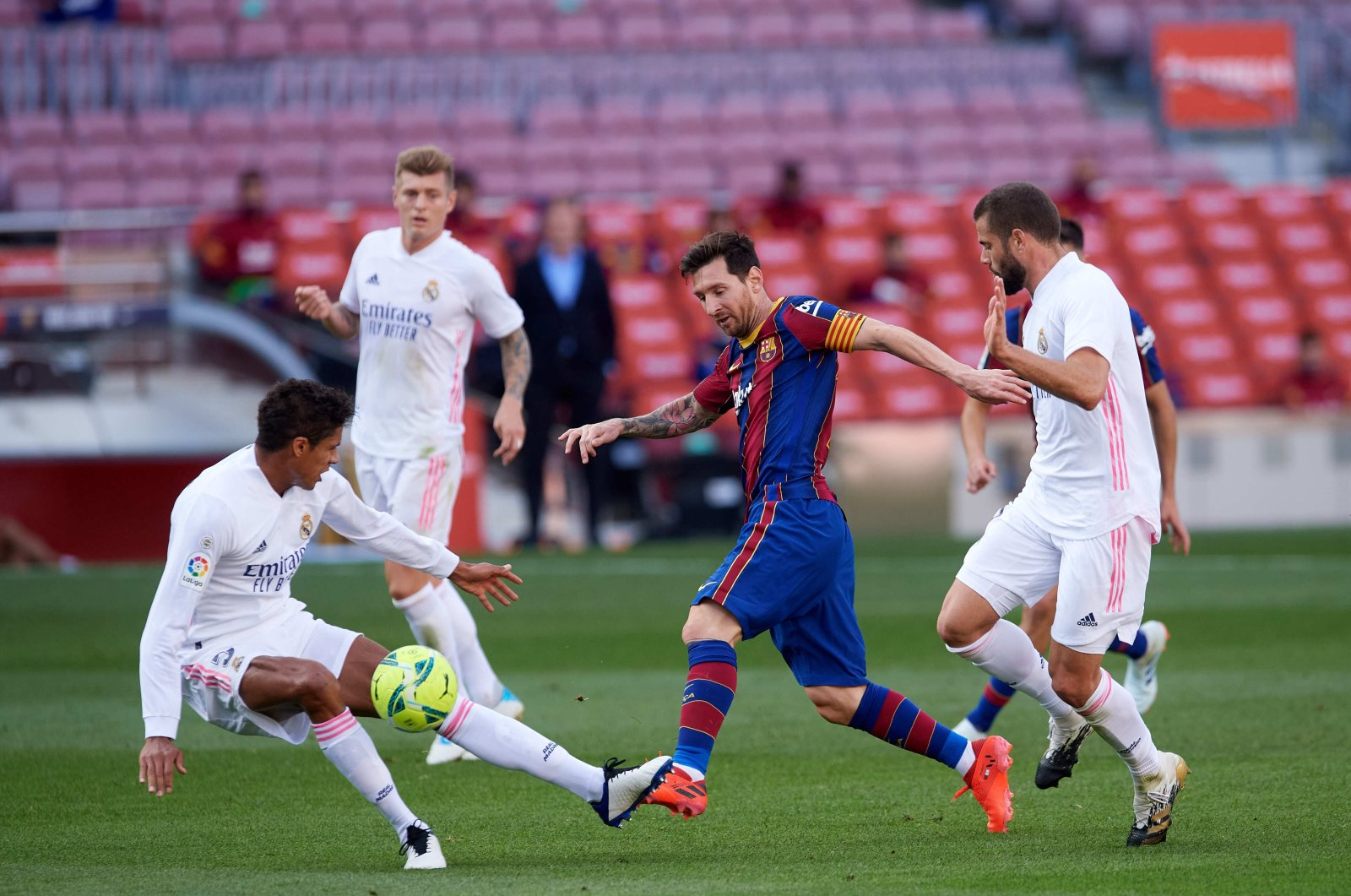 Barcelona's Lionel Messi (C) tries to dribble past Real Madrid's Raphael Varane (L) and Nacho Fernandez during a La Liga match at Camp Nou stadium in Barcelona, Spain, Oct. 24, 2020. (Getty Images)