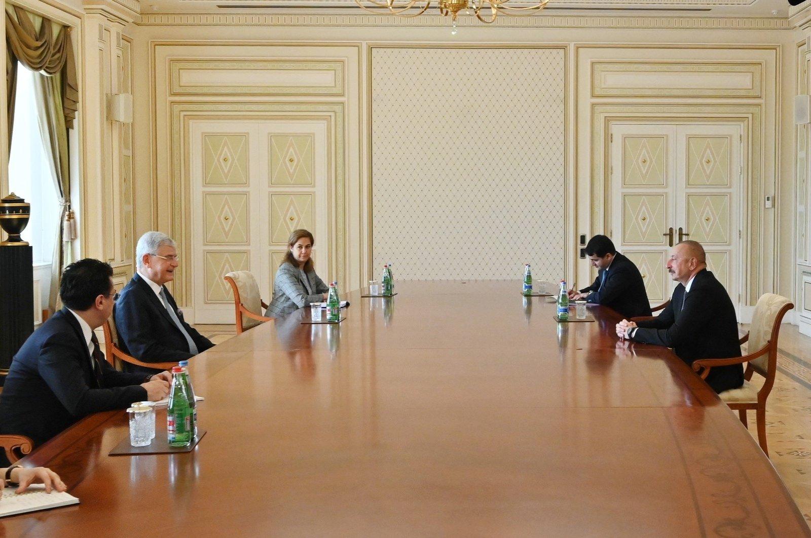Azerbaijan President Ilham Aliyev (R) receives U.N. 75th General Assembly President Volkan Bozkır (2nd L), in Baku, Azerbaijan, April 9, 2021. (AA Photos)