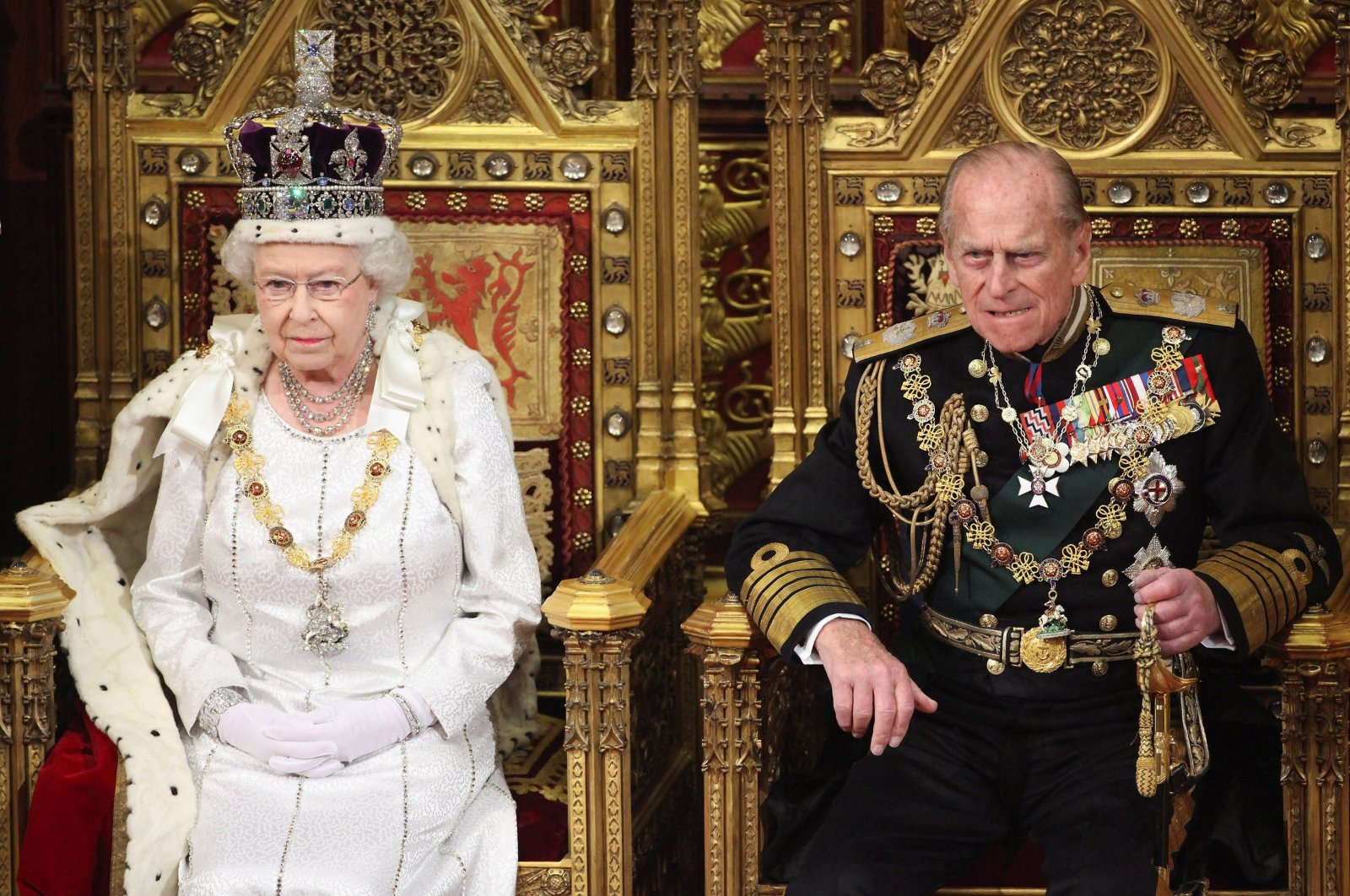 Britain's Queen Elizabeth waits to read the Queen's Speech to lawmakers in the House of Lords, next to Prince Philip, during the State Opening of Parliament in central London May 9, 2012. (Reuters Photo)