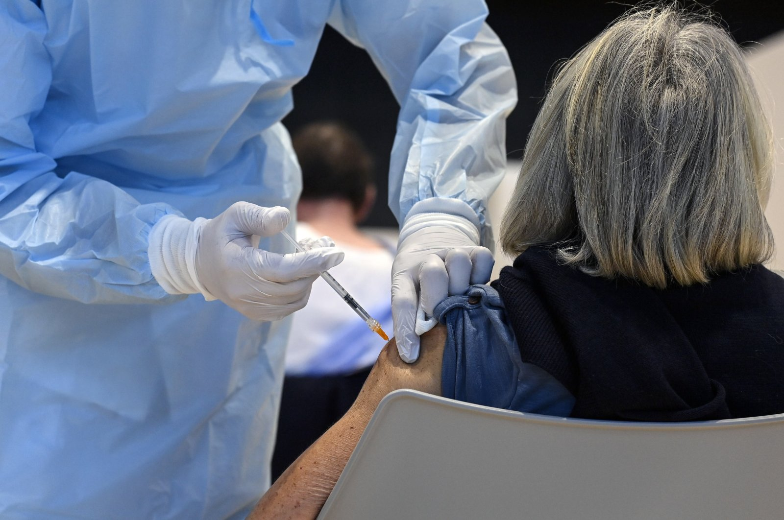 A woman receives a COVID-19 vaccine at the vaccination center set up at the La Nuvola congress center in Rome, Italy, April 4, 2021. (EPA Photo)