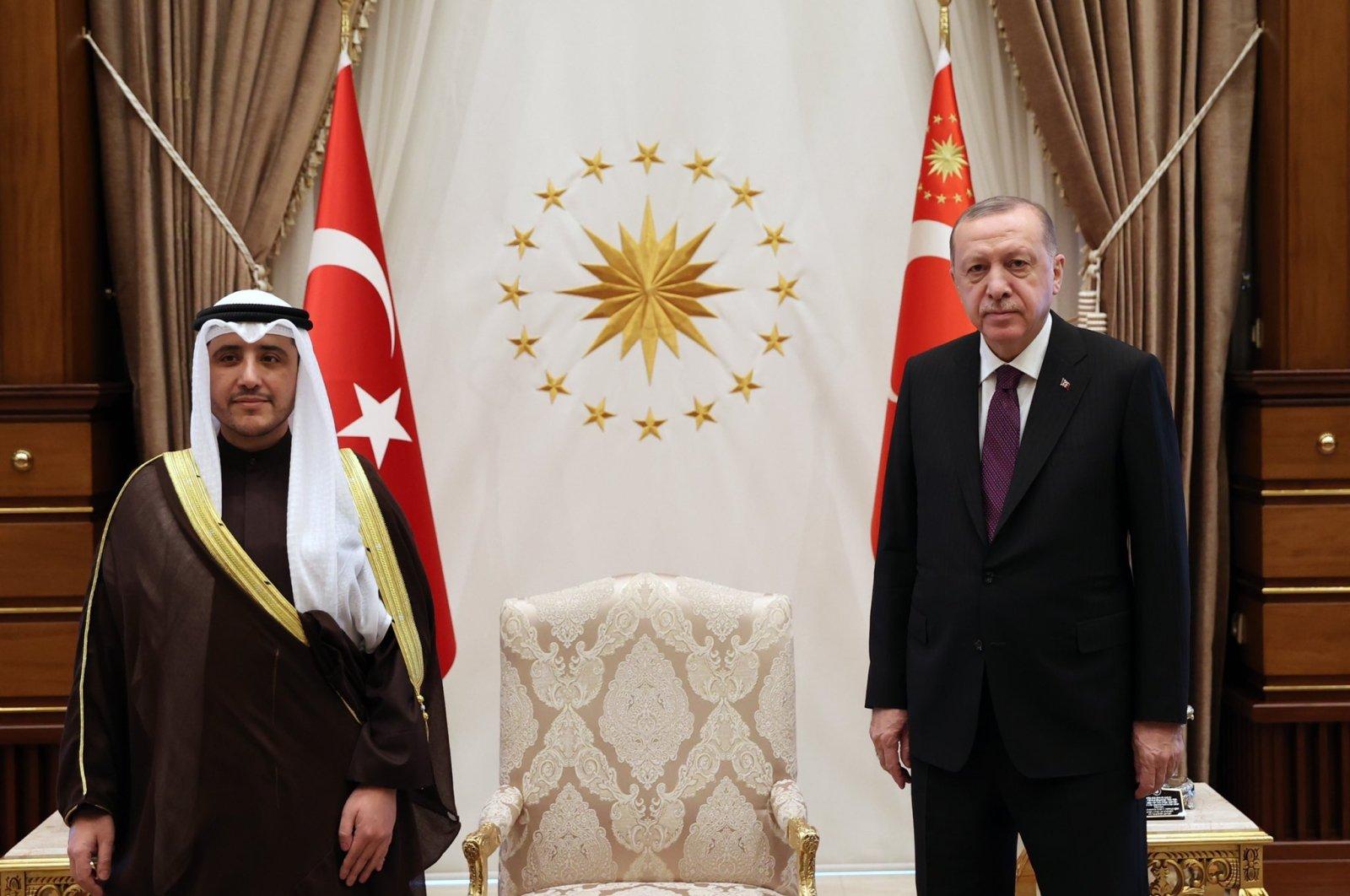 President Recep Tayyip Erdoğan poses with Kuwaiti FM Sheikh Ahmad Nasser al-Sabah at the Presidential Complex in Ankara, Turkey, April 8, 2021. (AA Photo)