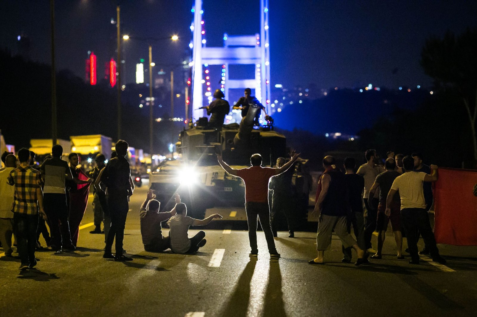 People take control of a tank near the Fatih Sultan Mehmet bridge during clashes with coup forces in Istanbul, Turkey, July 16, 2016. (AFP Photo)