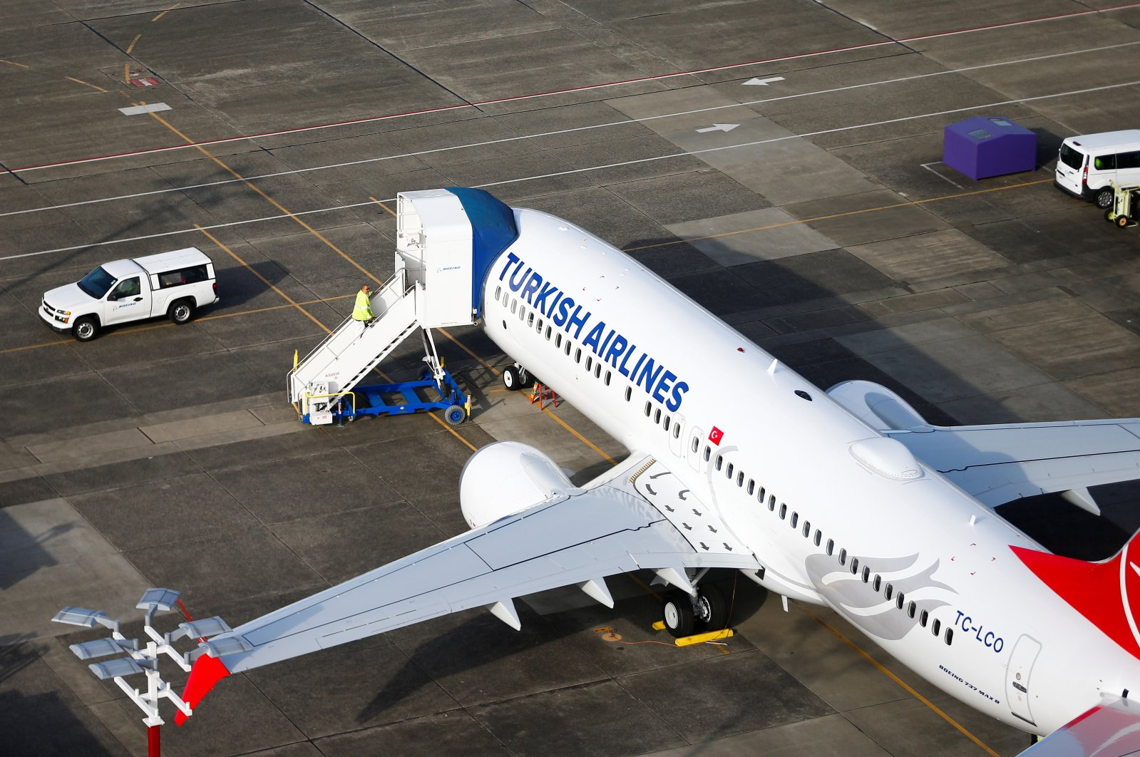 A worker climbs up to a Turkish Airlines Boeing 737 Max airplane grounded at Boeing Field in Seattle, Washington, U.S. March 21, 2019. (Reuters Photo)