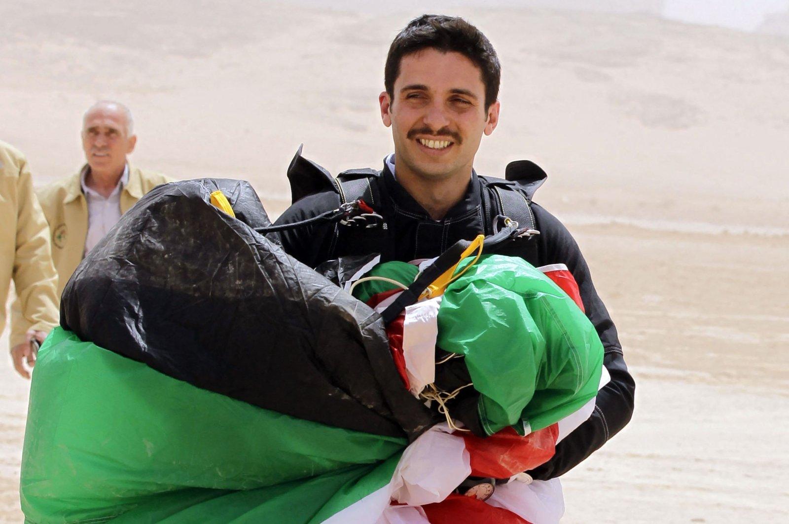 "Jordanian Prince Hamzah bin Hussein, president of the Royal Aero Sports Club of Jordan, carries a parachute during a media event to announce the launch of ""Skydive Jordan"", in the Wadi Rum desert, Jordan, April 17, 2012. (AFP Photo)"