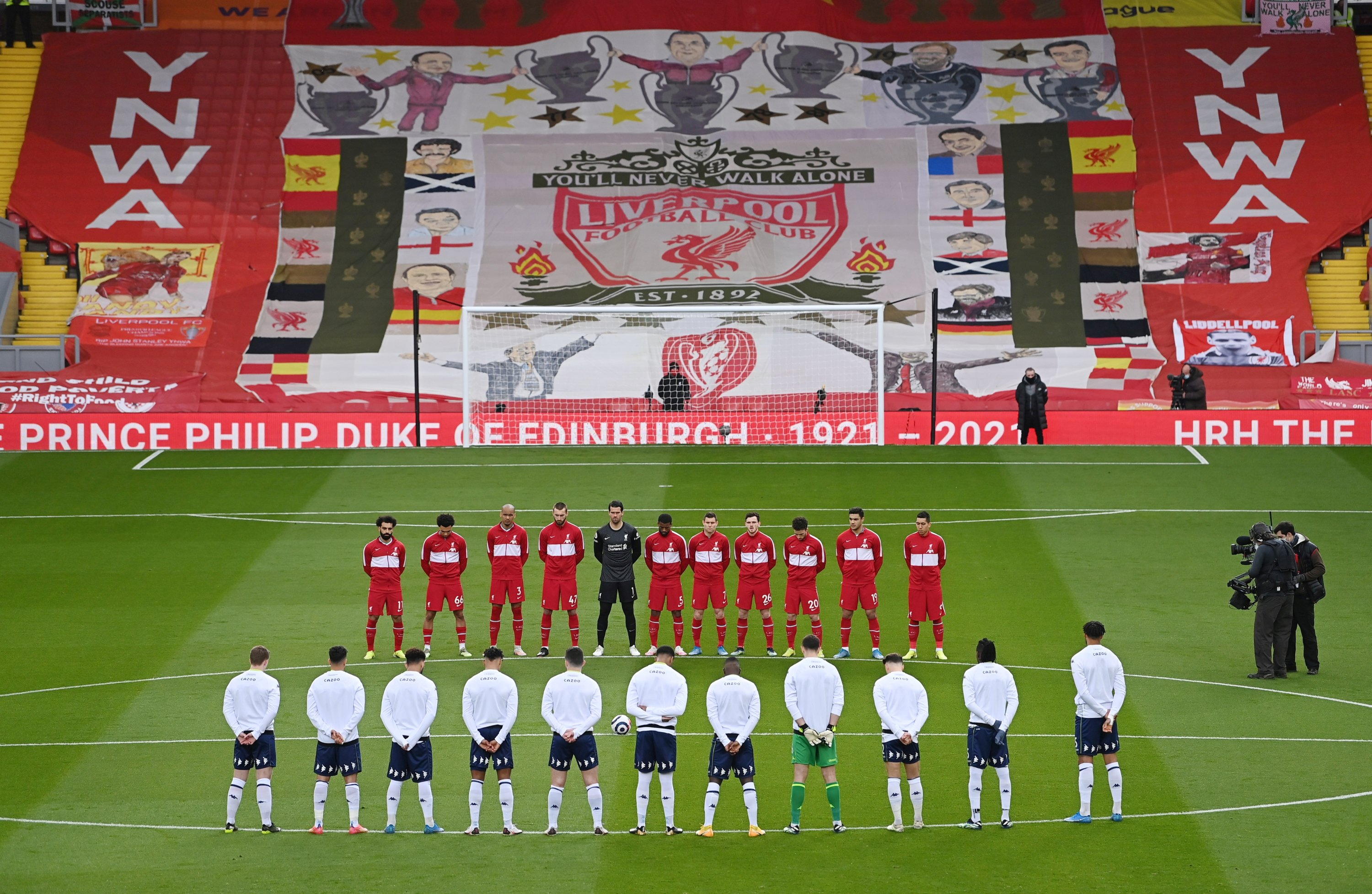 General view of players during a two minute silence after Britain's Prince Philip, husband of Queen Elizabeth, died at the age of 99, ahead of Premier League match between Liverpool and Aston Villa at Anfield, Liverpool, Britain, April 10, 2021. (Reuters/Laurence Griffiths/Pool Photo)