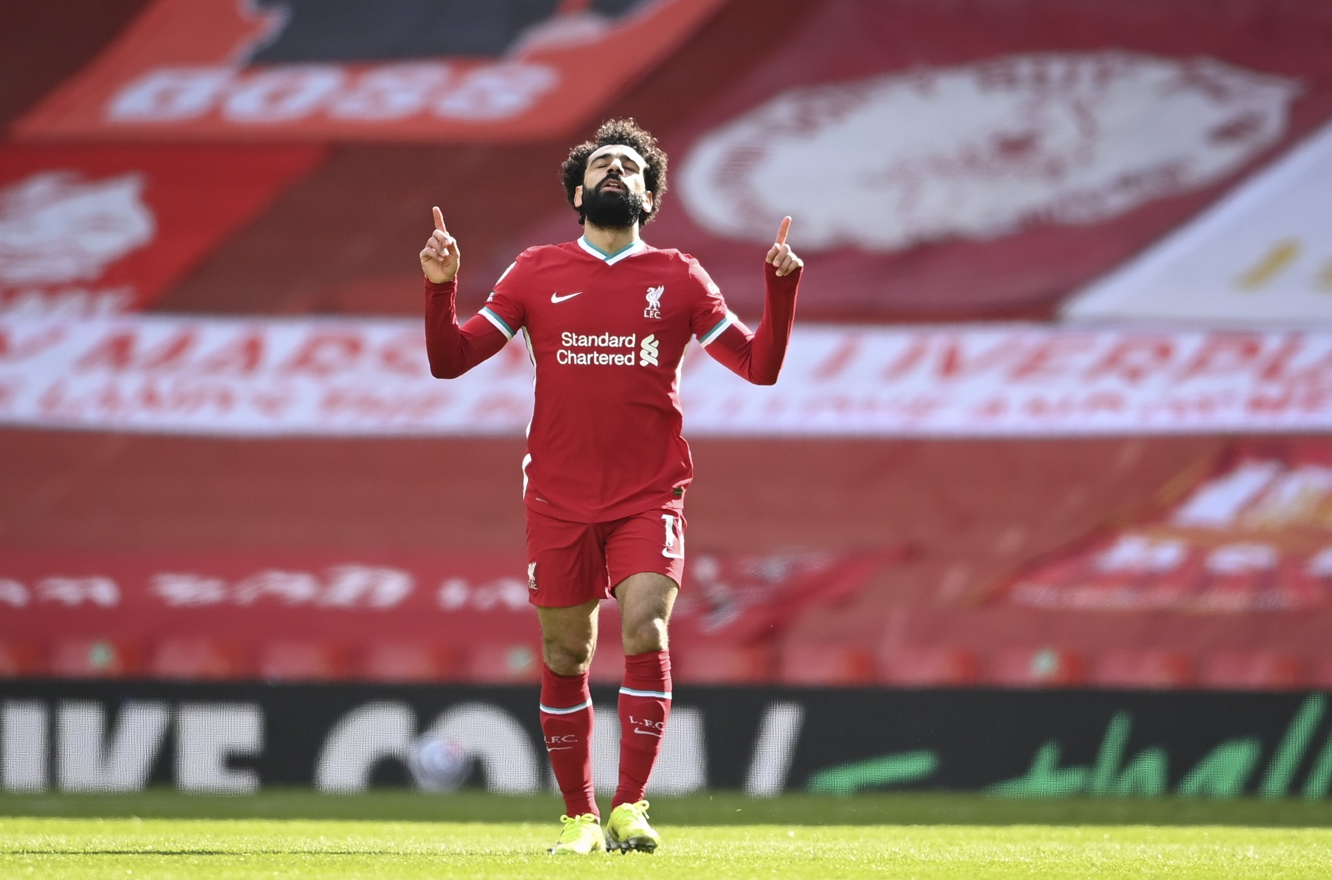 Liverpool's Mohamed Salah celebrates after scoring his side's opening goal during the English Premier League soccer match against Aston Villa at Anfield stadium in Liverpool, England, April 10, 2021. (AP/Laurence Griffiths/Pool Photo)