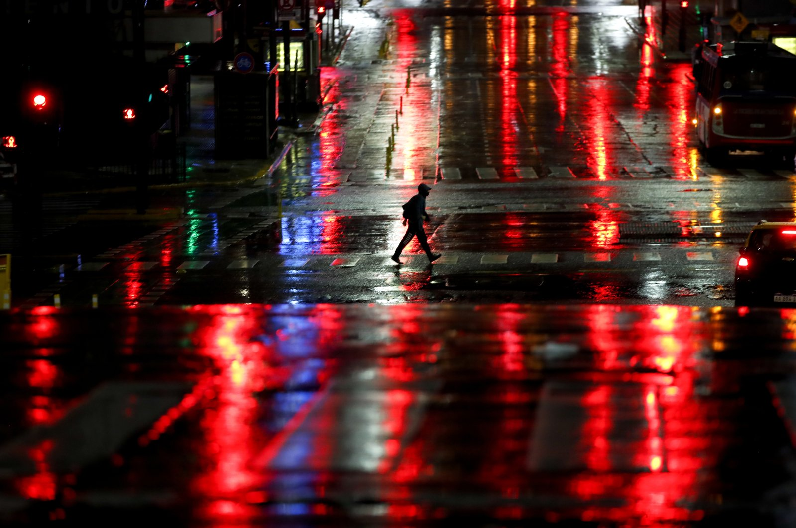 A man crosses Corrientes Avenue in Buenos Aires, Argentina, early Friday, April 9, 2021. (AP Photo)