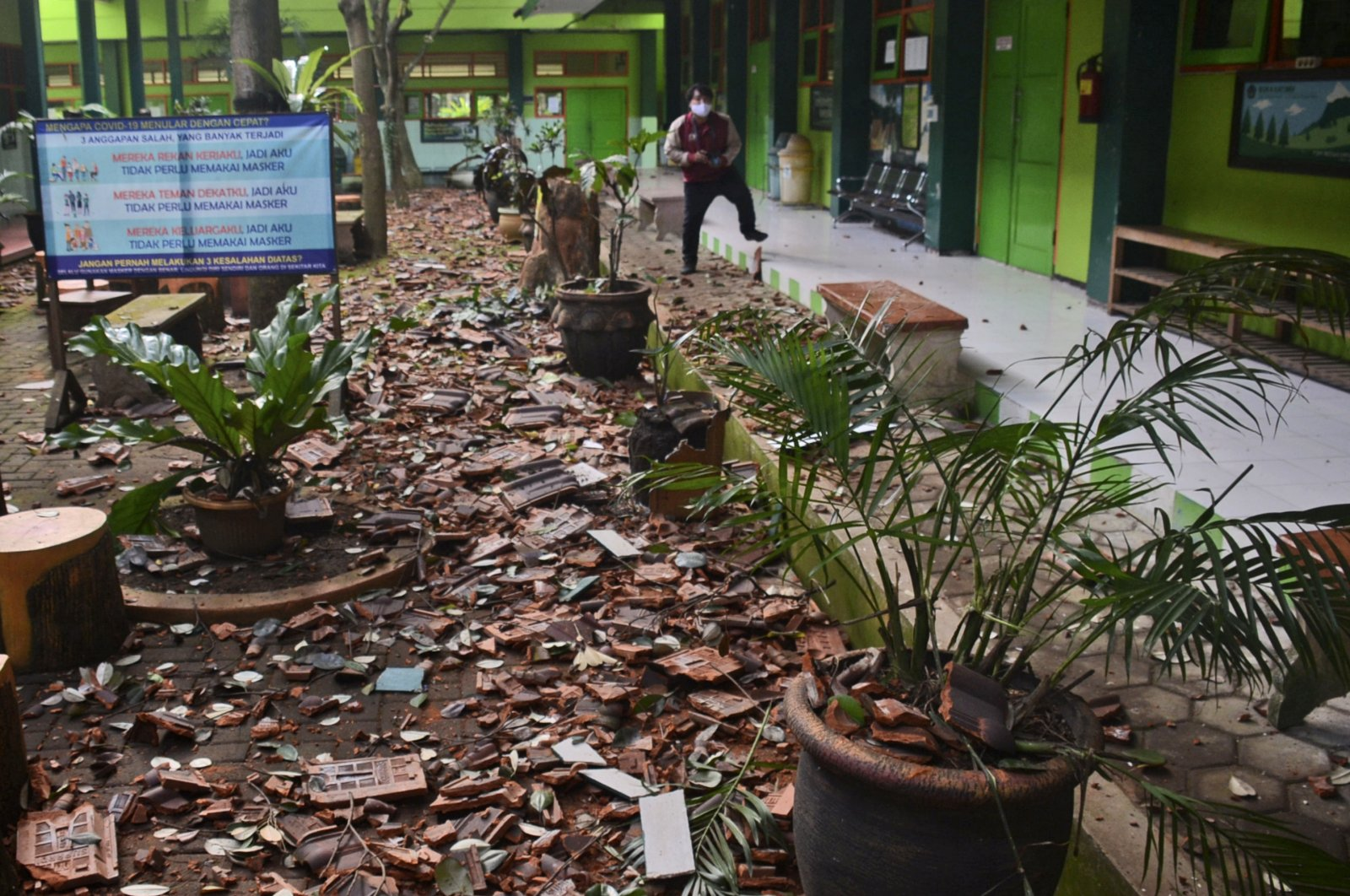 Pieces of roof tiles and other debris litter the ground at a school following an earthquake in Malang, East Java, Indonesia, Saturday, April 10, 2021. (AP Photo)