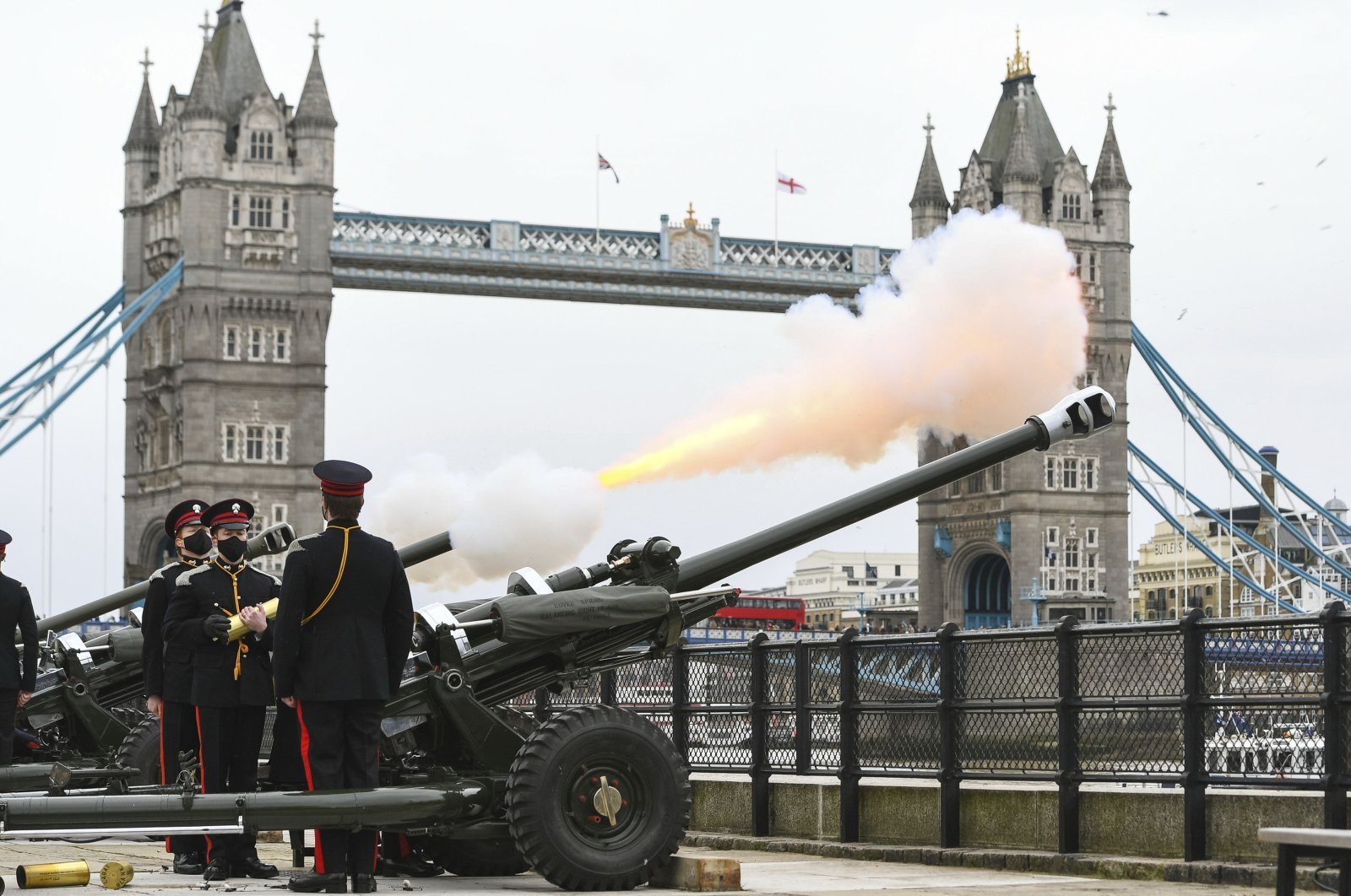 Members of the Honourable Artillery Company fire a 41-round gun salute from the wharf at the Tower of London, to mark the death of Prince Philip, London, U.K., Saturday, April 10, 2021. (PA via AP)