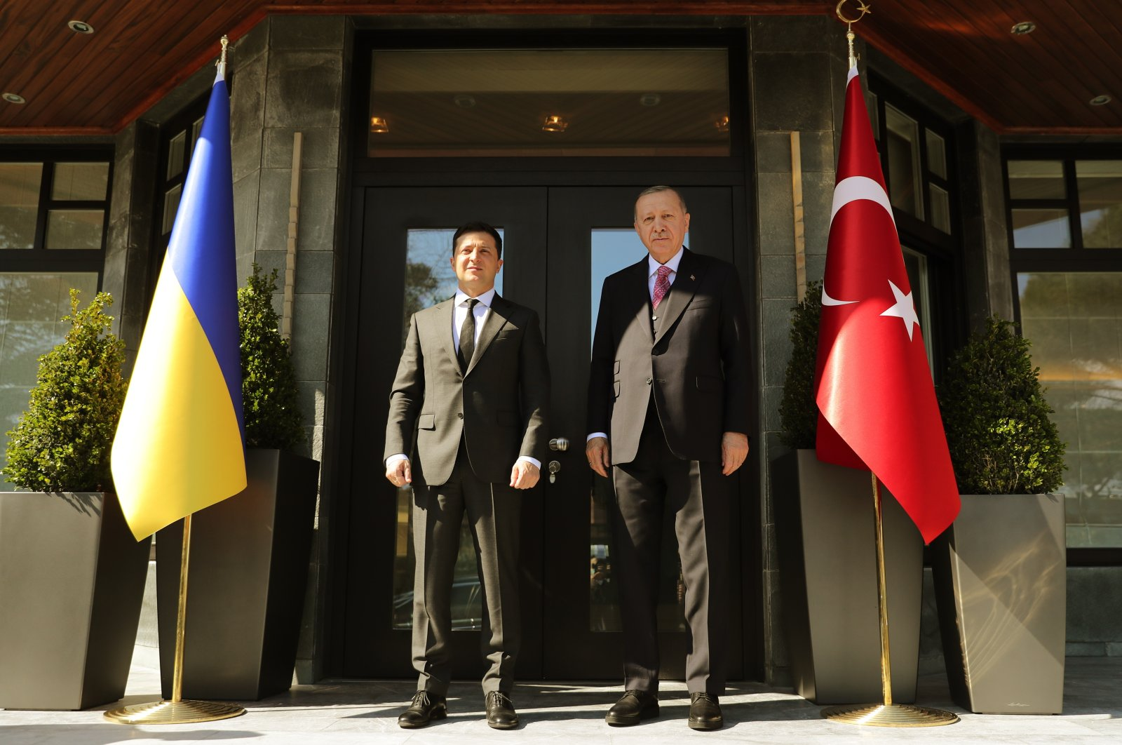 A handout photo made available by the Turkish President Press Office shows, Turkish President Recep Tayyip Erdoğan (R) and Ukraine's President Volodymyr Zelenskiy (L) before their meeting in Istanbul, Turkey, April 9, 2021.  (EPA/Turkish president press office Photo)