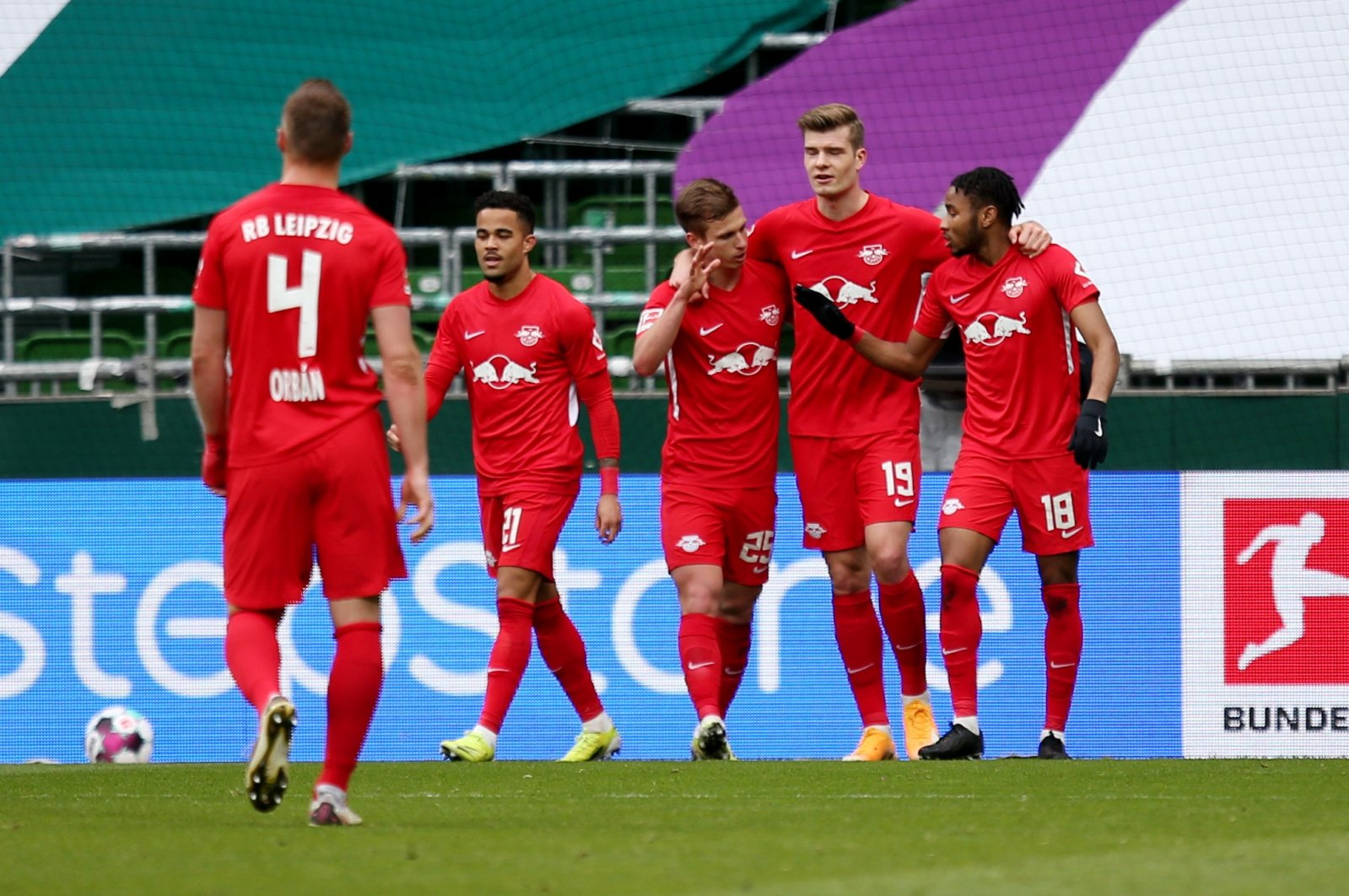 RB Leipzig's Alexander Sorloth (2ndR) celebrates scoring their second goal with teammates during the Bundesliga match against Werder Bremen at Weser-Stadion, Bremen, Germany, April 10, 2021. (Cathrin Mueller/DFL/Pool via Reuters)