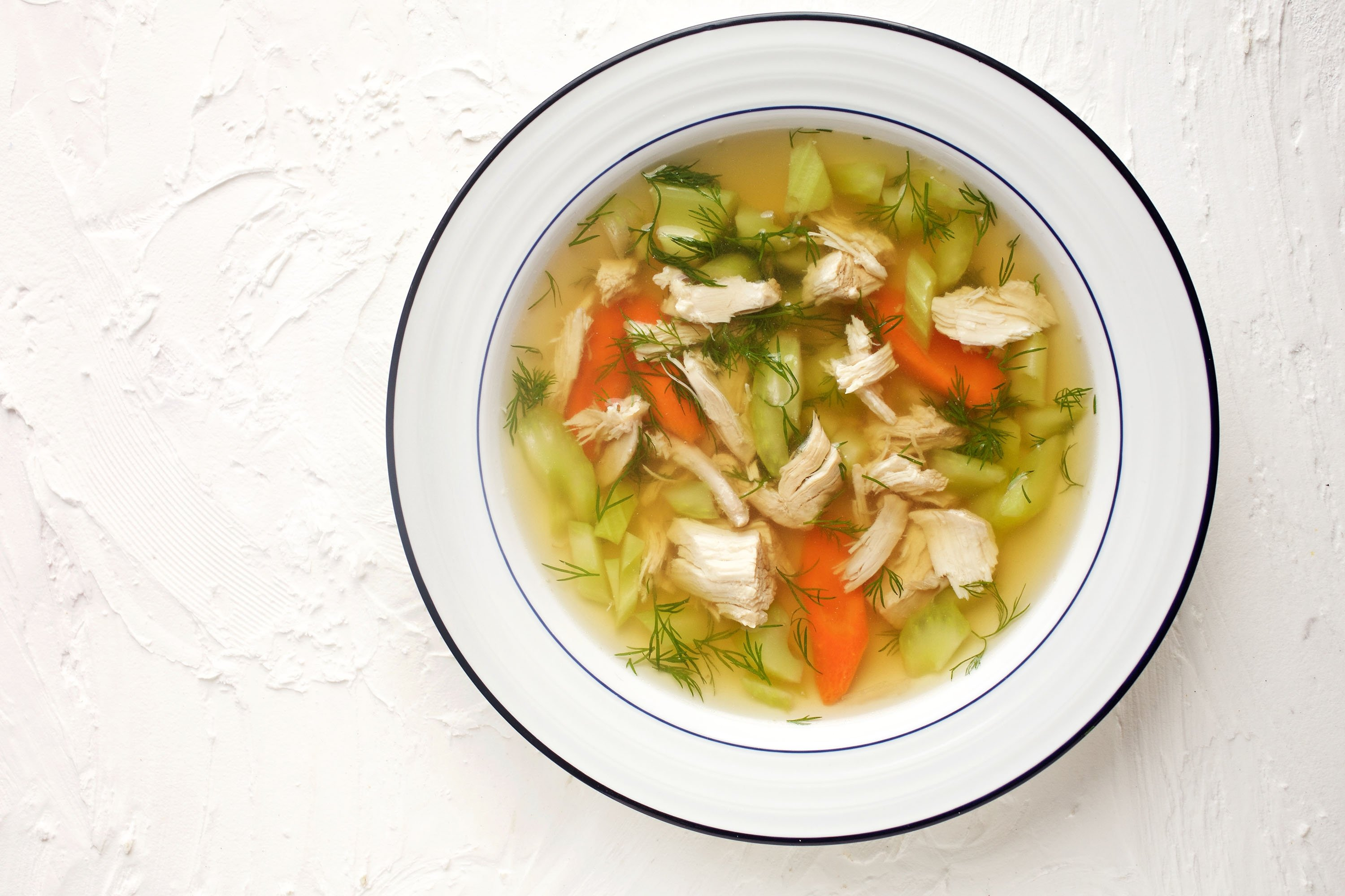 A chicken soup is never complete without a rainbow of vegetables. (via Getty Images)