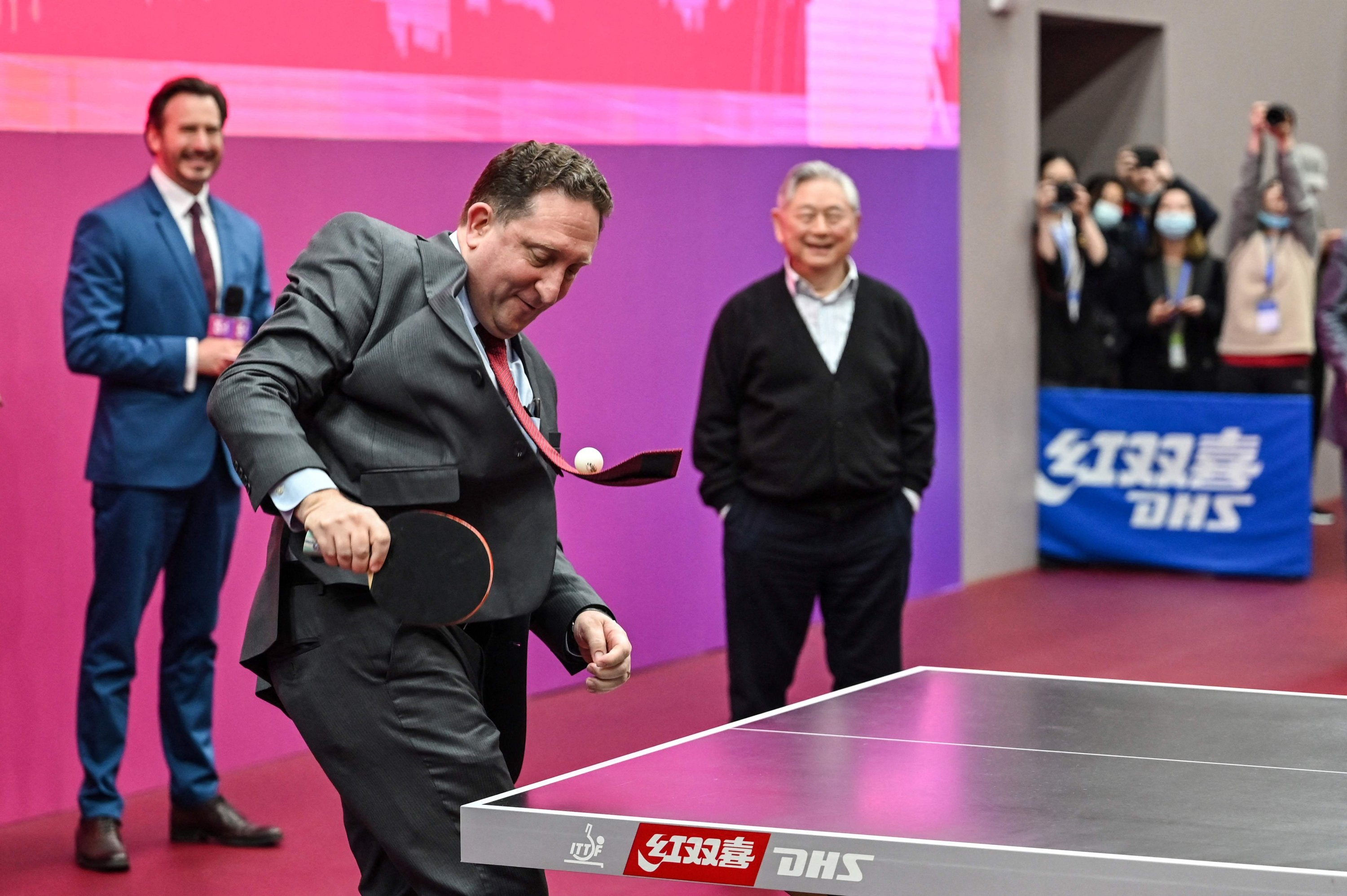 U.S. Consul General in Shanghai James Heller plays table tennis during a ceremony to mark the 50th anniversary of Ping Pong diplomacy, at the International Table Tennis Federation museum, Shanghai, China, April 10, 2021. (AFP Photo)