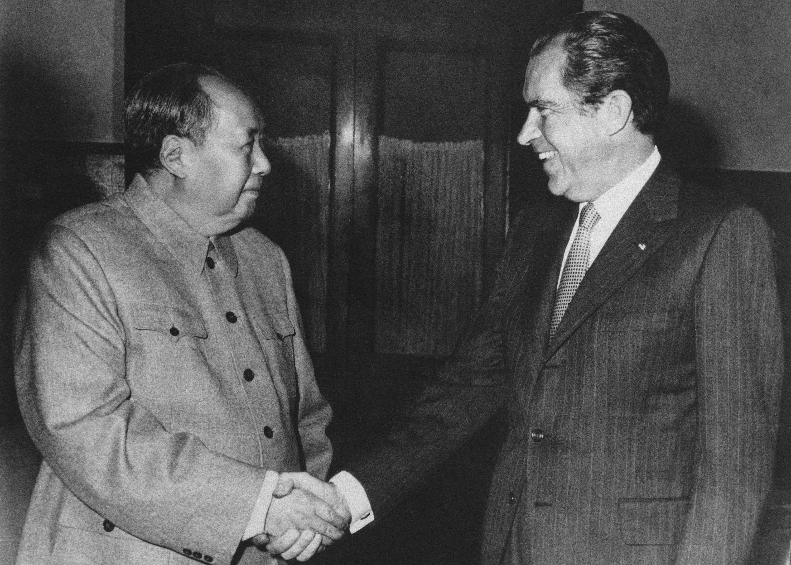 Chinese communist party leader Mao Zedong (L) and U.S. President Richard Nixon shake hands as they meet in Beijing, China, Feb. 21, 1972. (AP Photo)