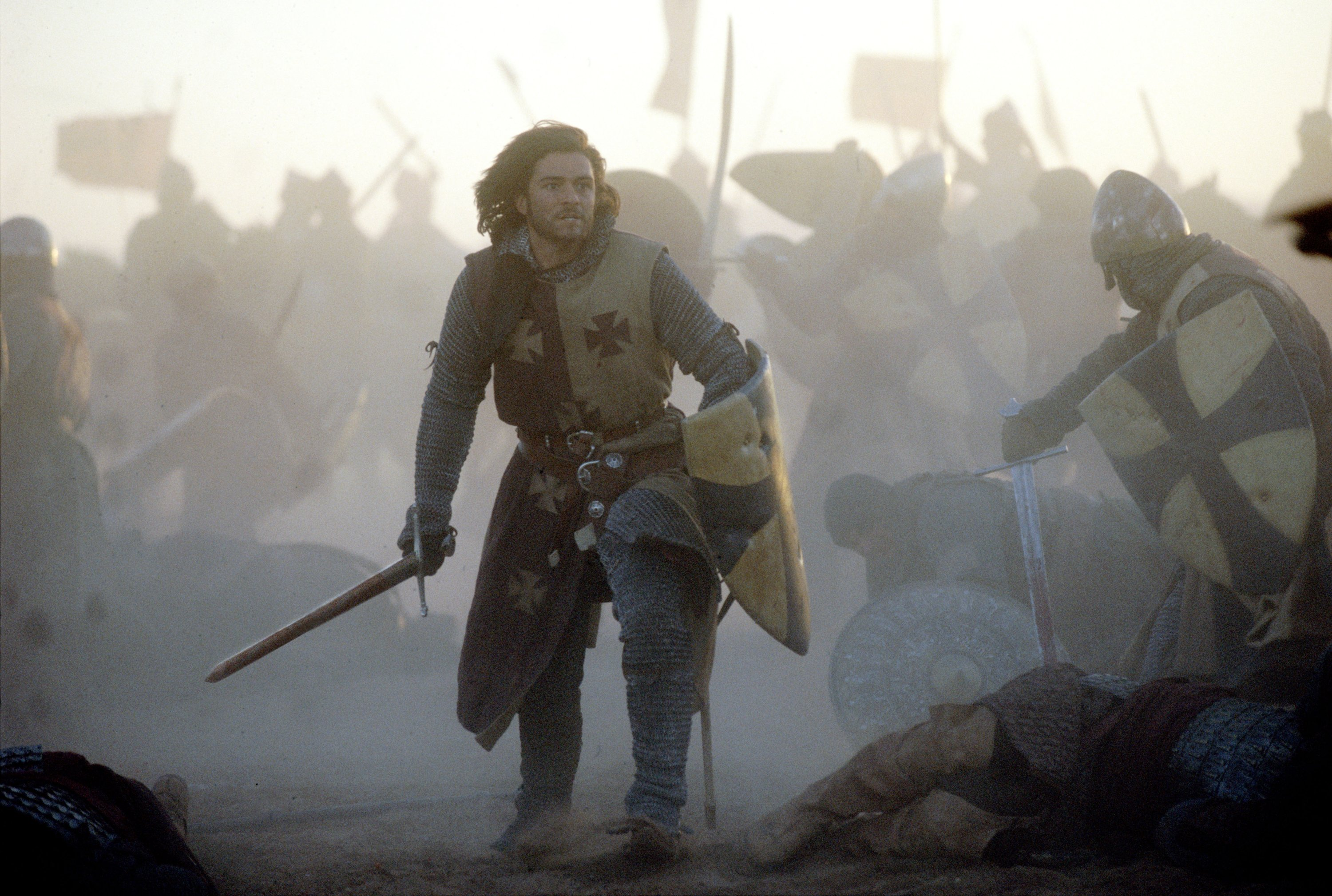 "Orlando Bloom as Balian of Ibelin fights alongside other Crusaders wielding a sword and a shield in a scene from the 2005 film ""Kingdom of Heaven."" (Archive Photo)"