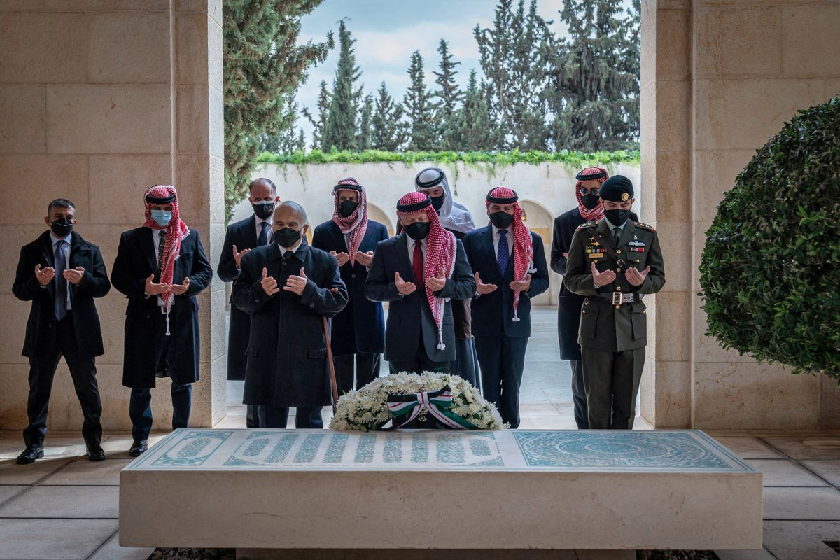 Prince Hamzah (2nd-L), Jordanian King Abdullah II (C) and Crown Prince Hussein (R) stand next to the tomb of the late King Hussein at Raghadan Palace in the capital Amman, Jordan, April 11, 2021. (Handout picture released by the Jordanian Royal Palace/ AFP Photo)