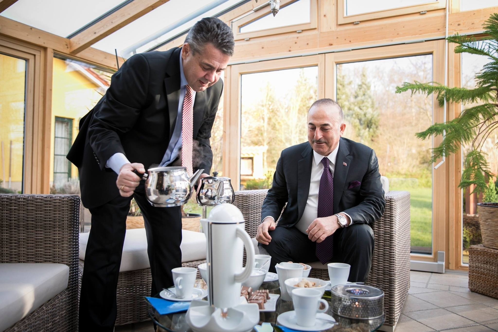 Then German Foreign Minister Sigmar Gabriel (L) pours Turkish tea for Foreign Minister Çavuşoğlu in Gabriel's residence in his hometown Goslar, central Germany, Jan. 6, 2018. (AA Photo)