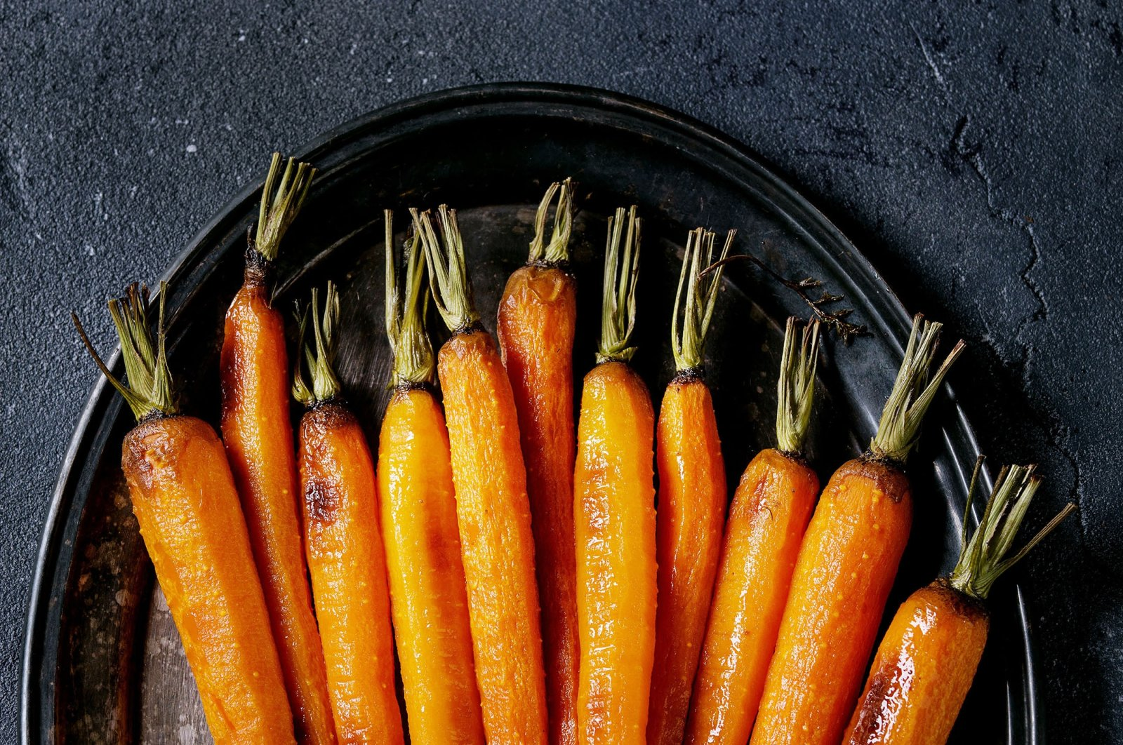 If you happen to have baby or young carrots, roast them whole and don't bother chopping them up. (via Getty Images)