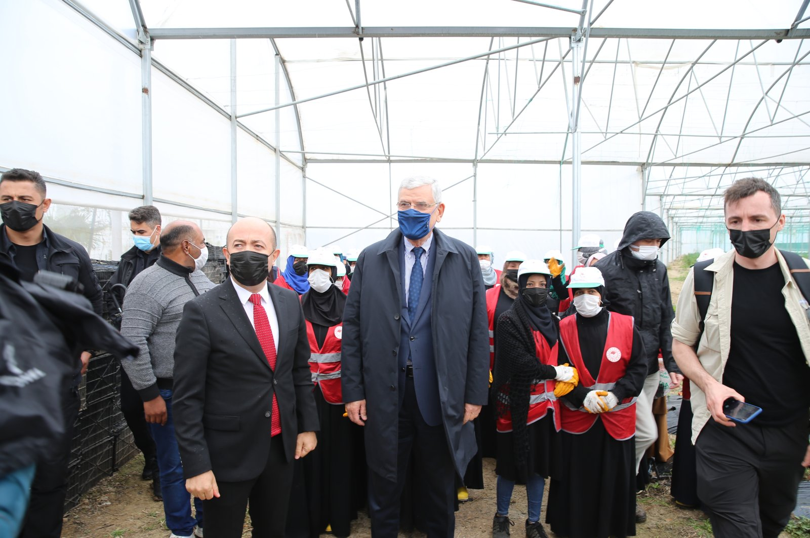 The Turkish diplomat heading the United Nations General Assembly, Volkan Bozkır (C), visits the Boynuyoğun Temporary Refuge Center in the Altınozu district of Hatay province, Turkey, April 10, 2021. (AA)