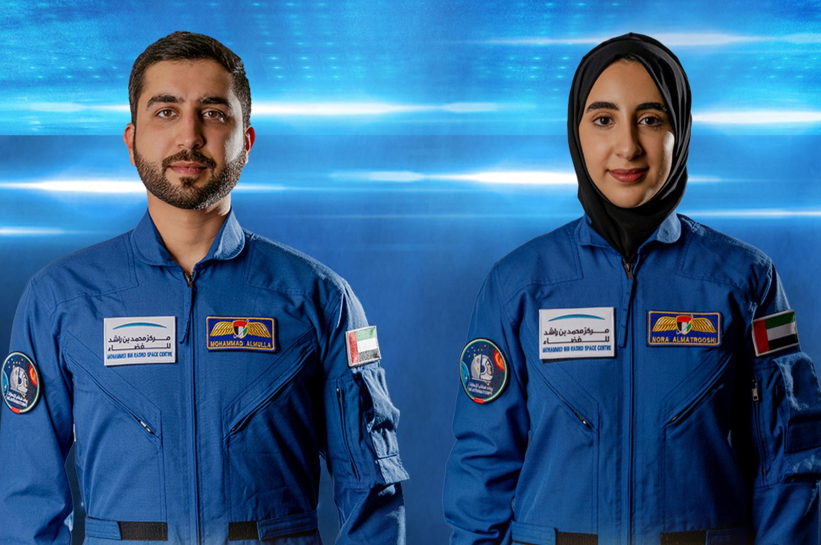 A handout photo made available by Emirates News Agency (WAM) shows Mohammed al-Mulla (L) and Noura al-Matroushi, the newly announced UAE astronauts for the country's space program, United Arab Emirates, April 10, 2021. (Emirates News Agency Photo via epa)