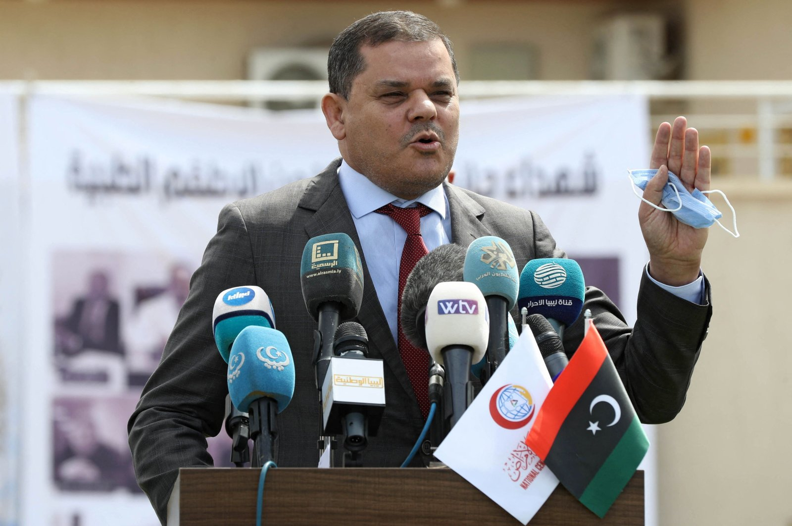 Libyan Prime Minister Abdelhamid Dbeibah delivers a speech outside the Centre for Disease Control in the capital Tripoli, Libya, April 10, 2021. (Mahmud TURKIA / AFP)