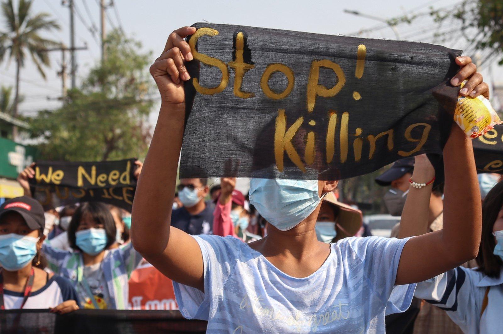 Demonstrators hold banners during an anti-military coup protest in Mandalay, Myanmar, April 11, 2021. (EPA Photo)