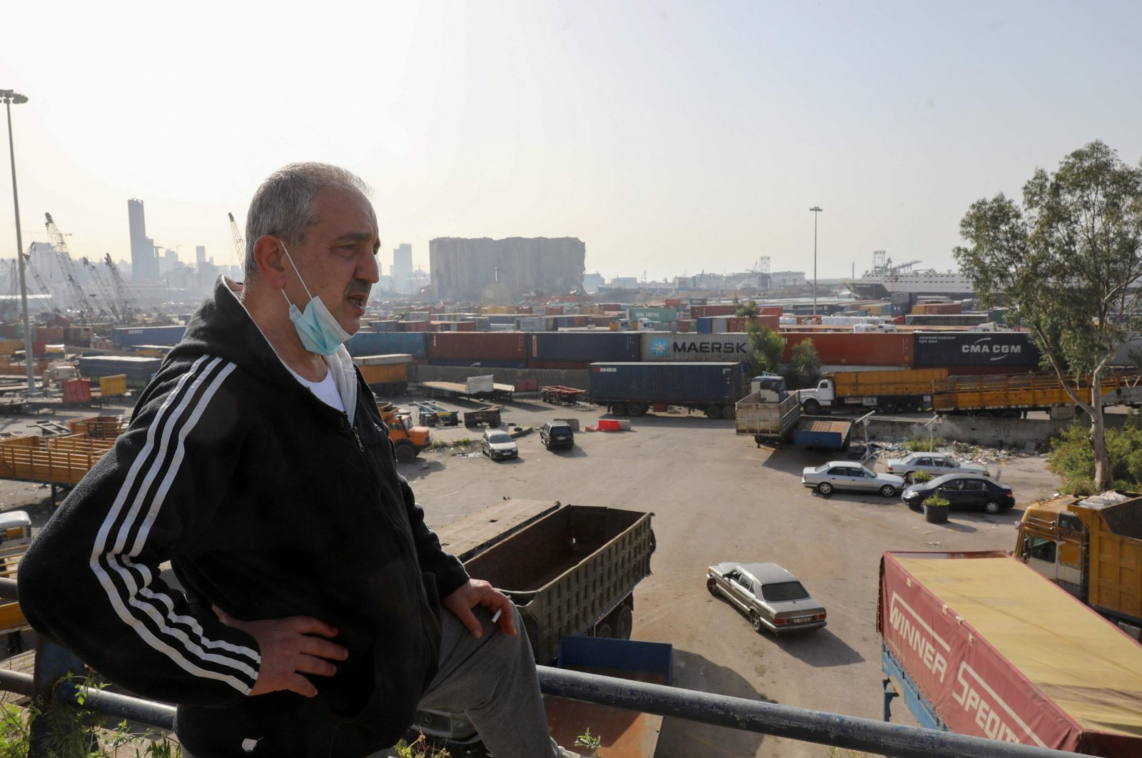 Civil war survivor Jean Saliba is pictured on a balcony overlooking the port of Beirut, in the Karantina district of the Lebanese capital, Lebanon, April 6, 2021. (AFP Photo)