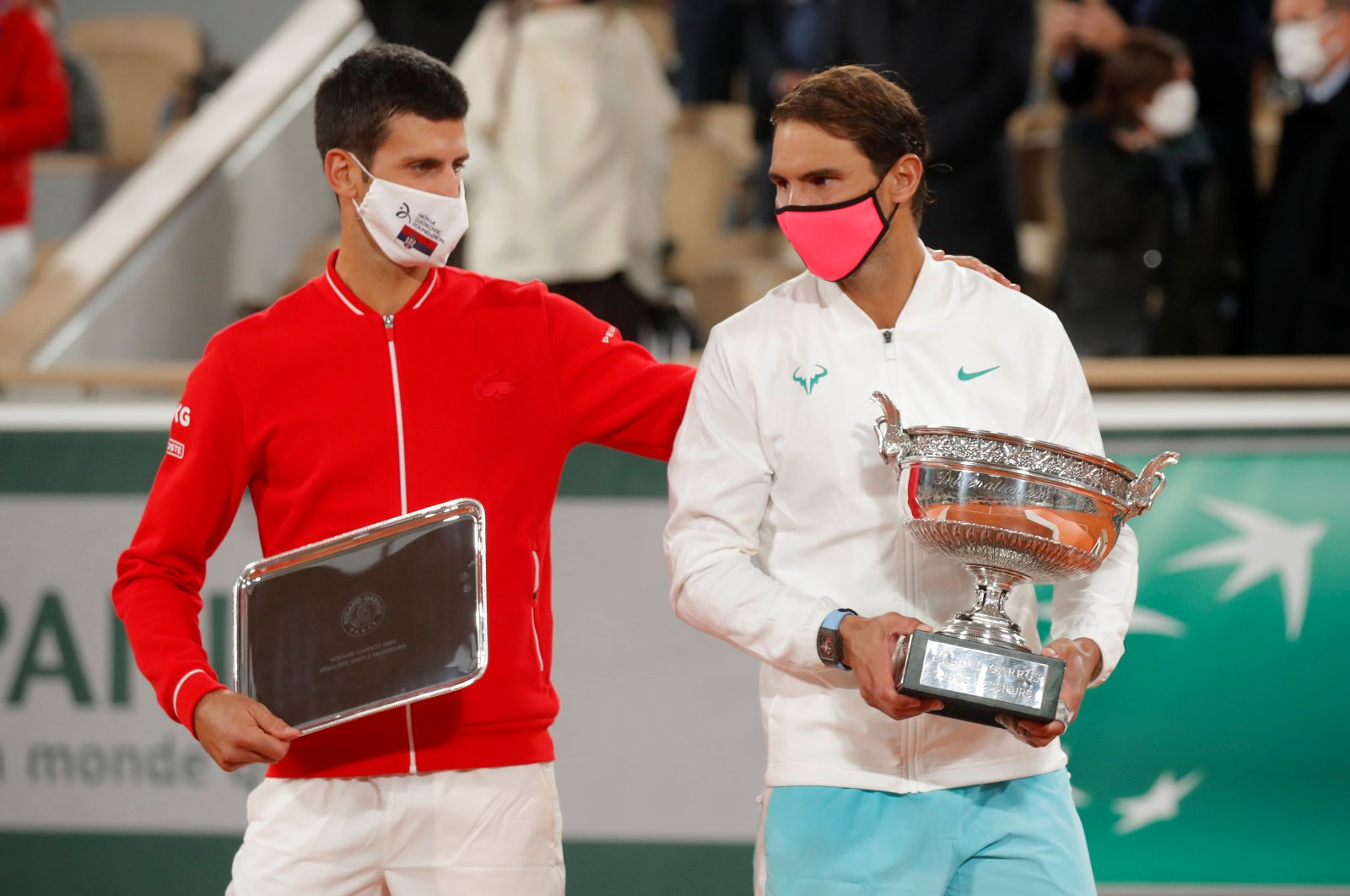 Runner-up Novak Djokovic of Serbia alongside French Open winner Rafael Nadal of Spain as they are presented with their trophies after the French Opean final, Roland Garros, Paris, France, Oct. 11, 2020. (Reuters Photo)