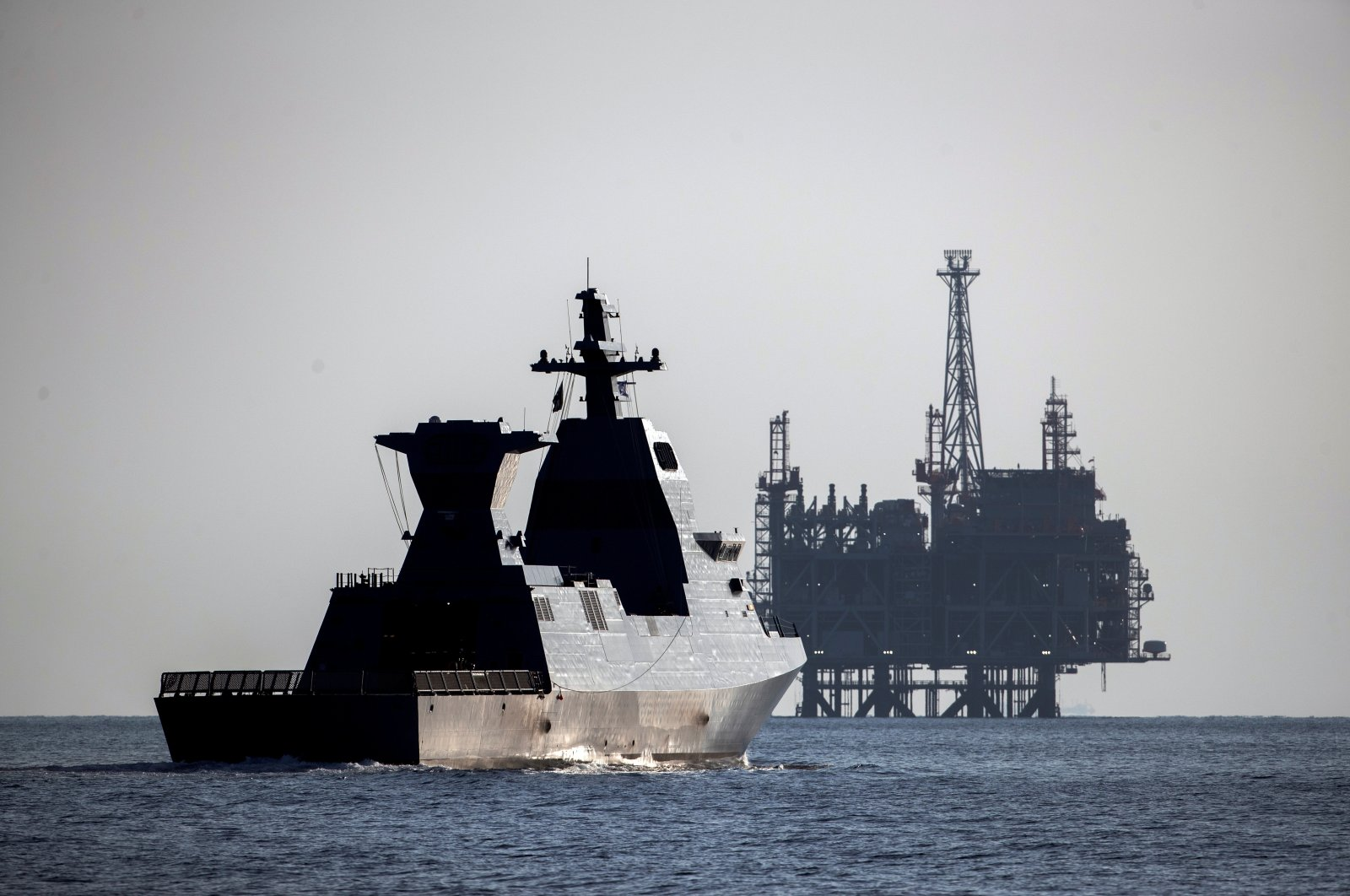 """Israel's Saar-6 corvette, a warship dubbed """"Shield,"""" cruises near the production platform of the Leviathan natural gas field after a welcoming ceremony by the Israeli navy marking its arrival in the Mediterranean Sea off the coast of Haifa, northern Israel, Dec. 1, 2020. (Reuters Photo)"""