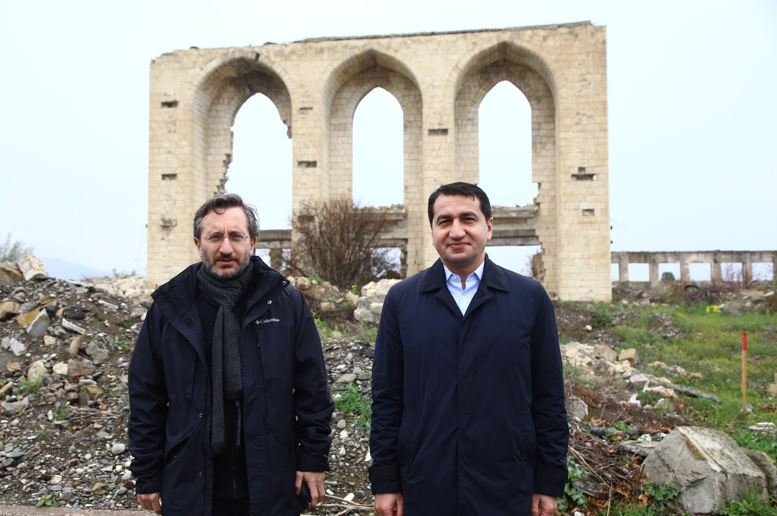 Presidential Communications Director Fahrettin Altun (L) and Azerbaijani Vice President Hikmet Haciyev pose for a picture during a visit to the city of Aghdam in Azerbaijan, April 11, 2021. (AA)