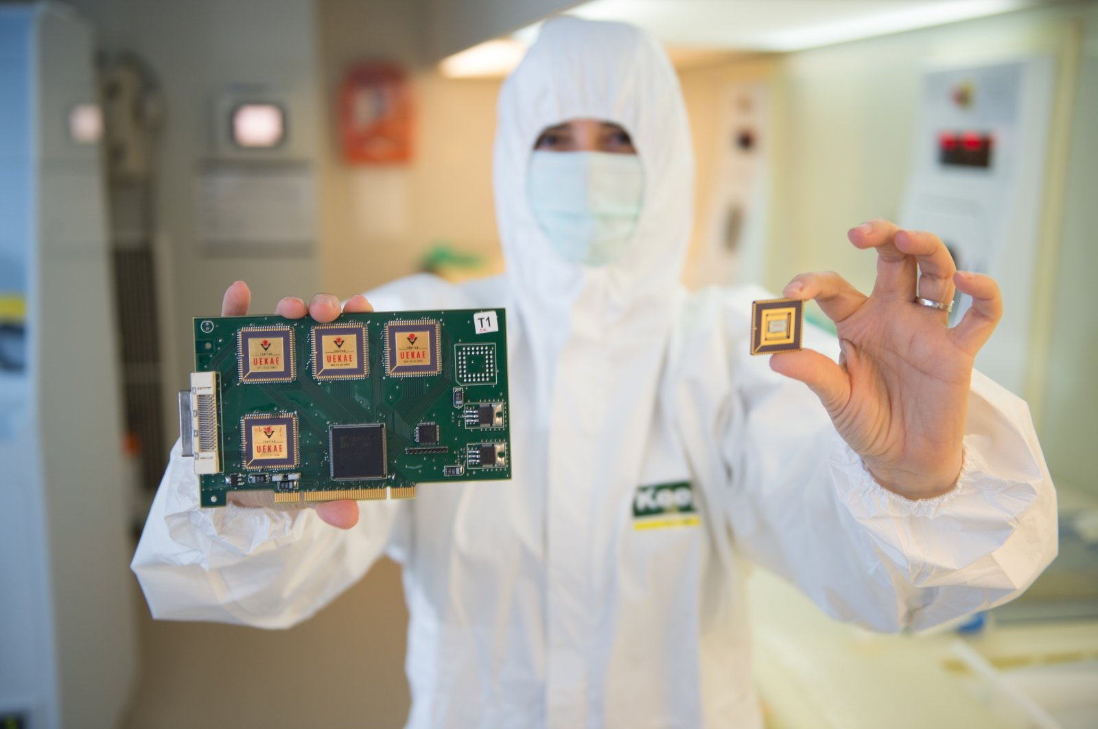 An engineer holds chips produced at a laboratory in the Gebze district of the northwestern province of Kocaeli, Turkey, April 9, 2021. (Photo by Ilhami Yıldırım)