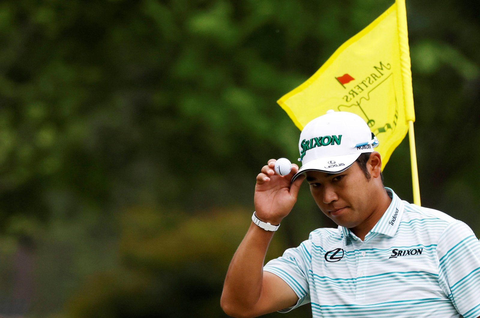 Japan's Hideki Matsuyama acknowledges the crowd after holing his eagle putt on the 15th green during the third round at the Masters, Augusta National Golf Club, Augusta, Georgia, U.S., April 10, 2021. (Reuters Photo)