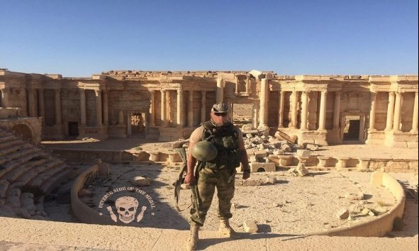 A Russian Wagner soldier is seen at the UNESCO-designated Palmyra site, northeast of Damascus, in this undated photo provided by security sources.