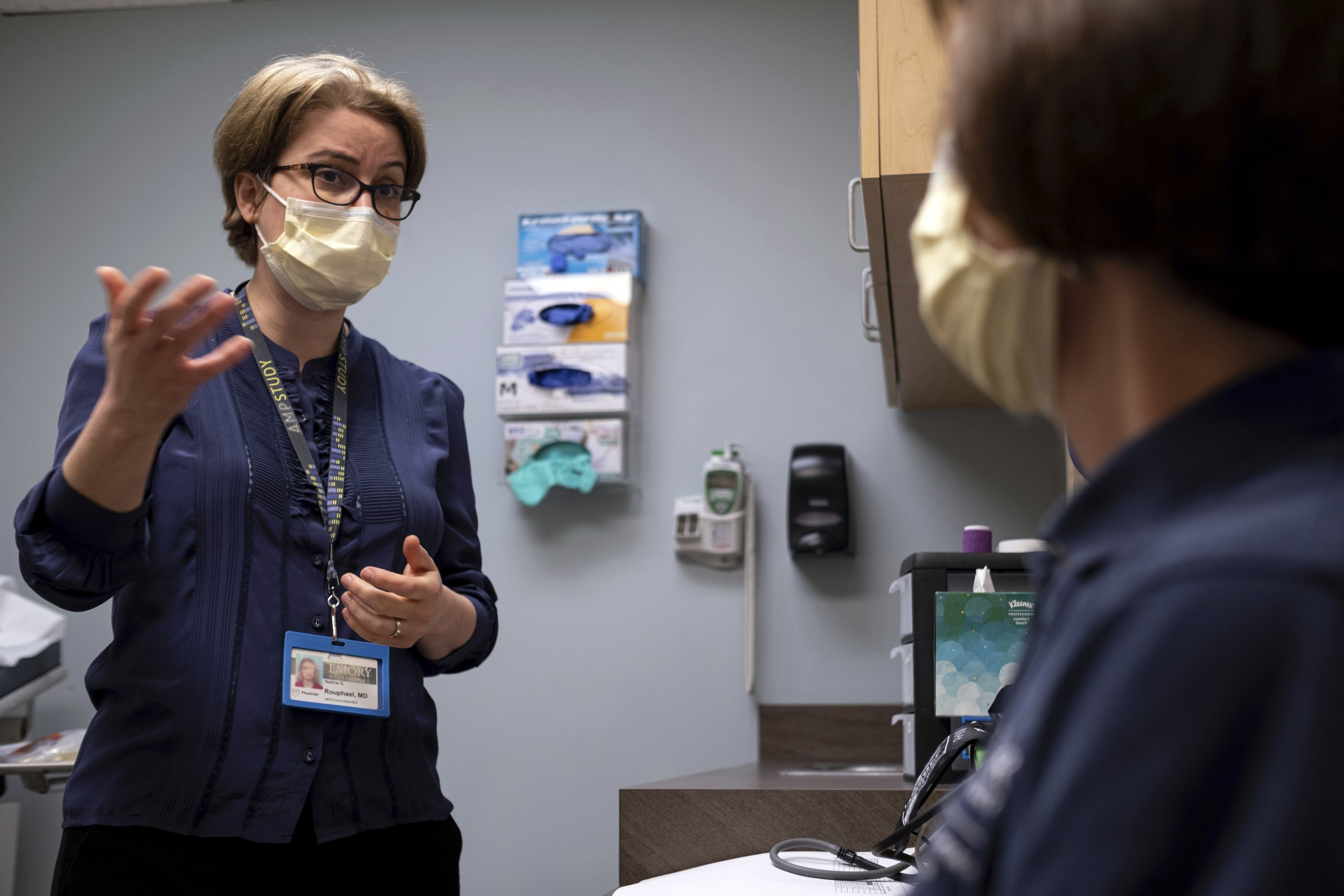 Dr. Nadine Rouphael (L), the principal investigator for the Moderna variant study and executive director of Emory University's Hope Clinic, talks with Carol Kelly, in Decatur, Georgia, the U.S., March 31, 2021. (AP Photo)